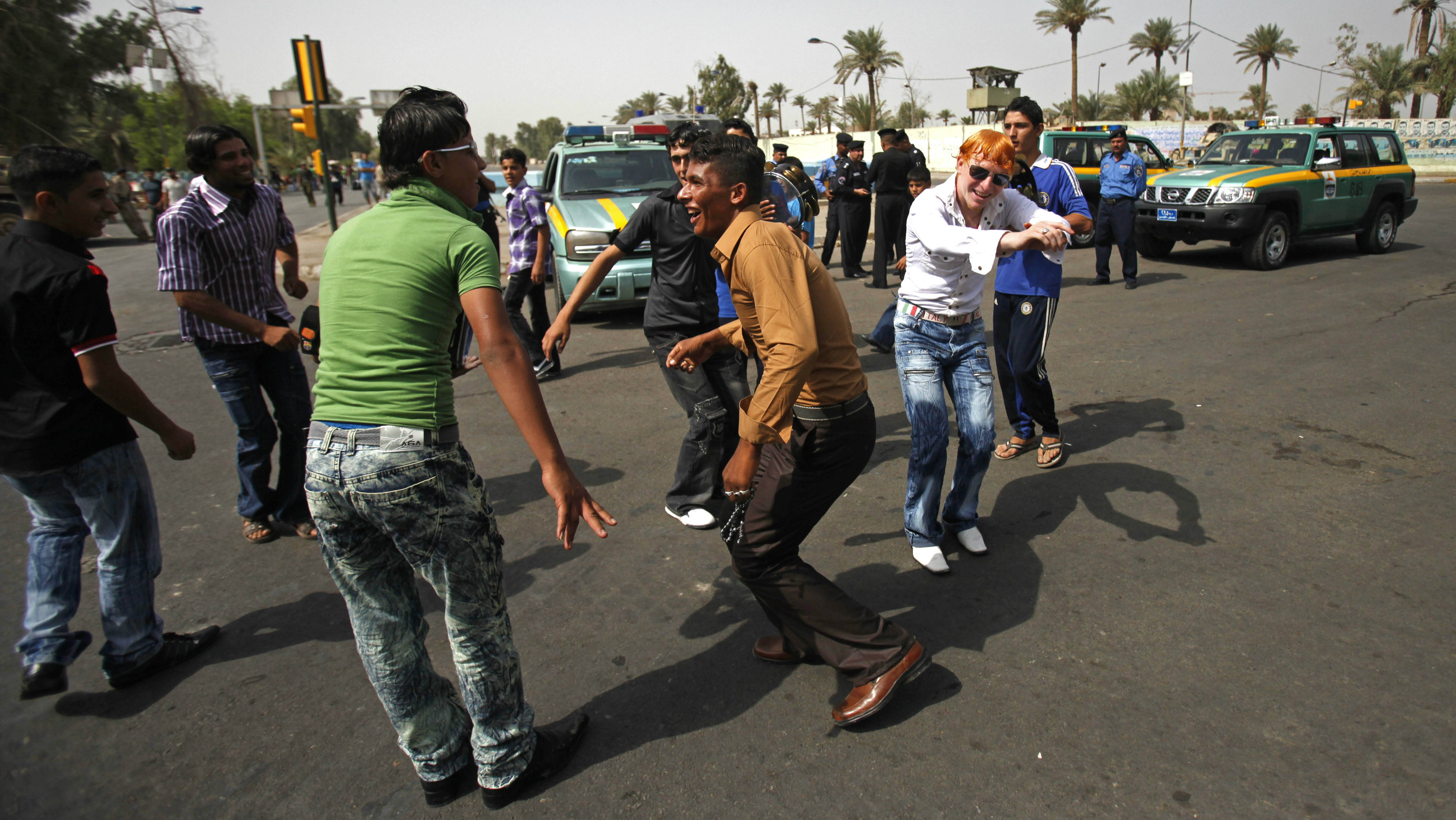 Iraqi teens dance in the street on the first day of Eid al-Fitr in Baghdad, Iraq, Sunday, Sept. 20, 2009.