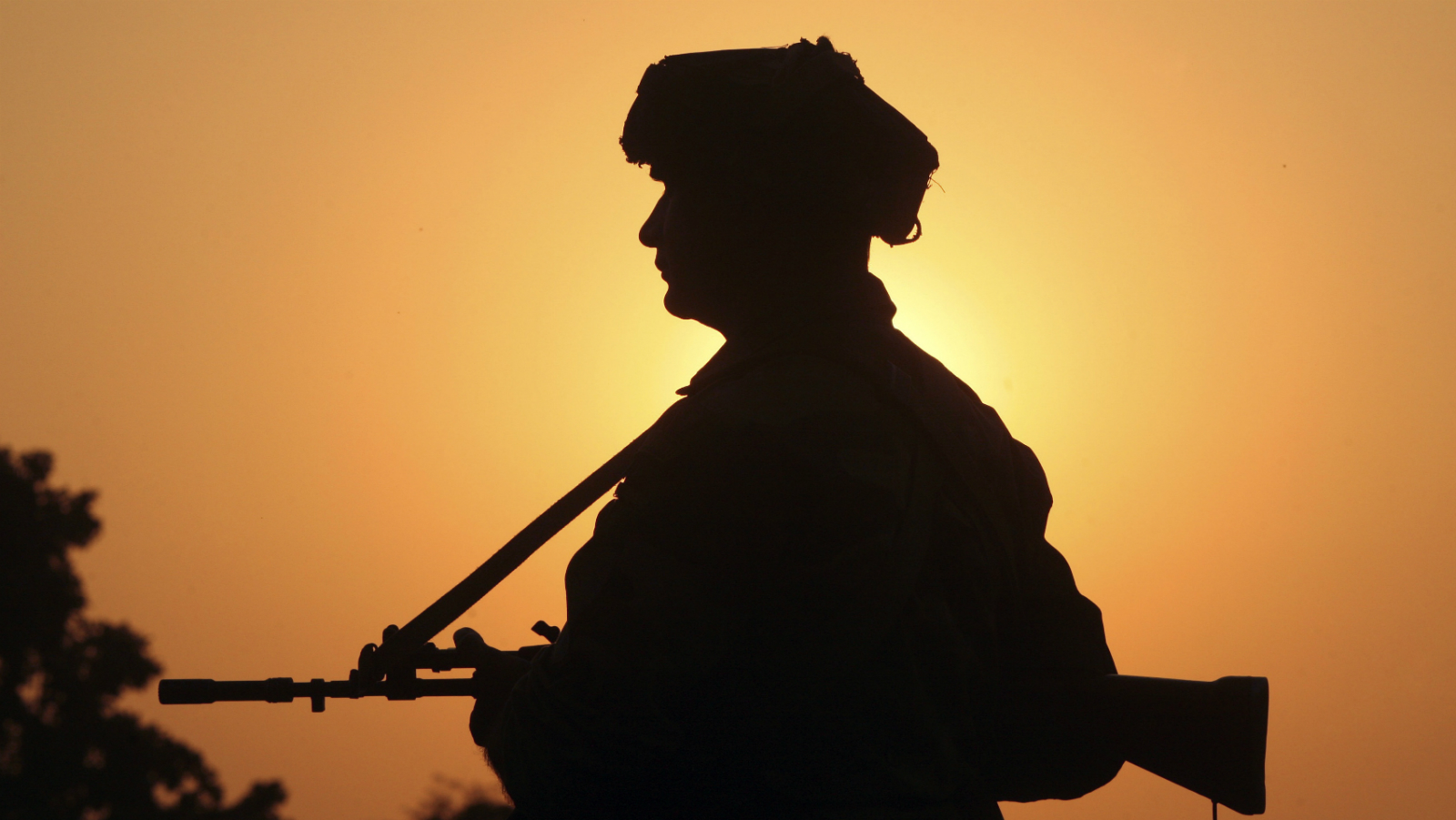 An Indian army soldier keeps vigil near the site of a gunbattle with suspected militants at Pindi Khattar village in Arnia near the border with Pakistan November 27, 2014. Gunmen wearing army uniforms on Thursday attacked an Indian army base near the border with Pakistan, leaving ten people dead in the worst militant violence in the disputed state of Kashmir in more than a year. REUTERS/Mukesh Gupta (INDIAN-ADMINISTERED KASHMIR - Tags: POLITICS CIVIL UNREST)