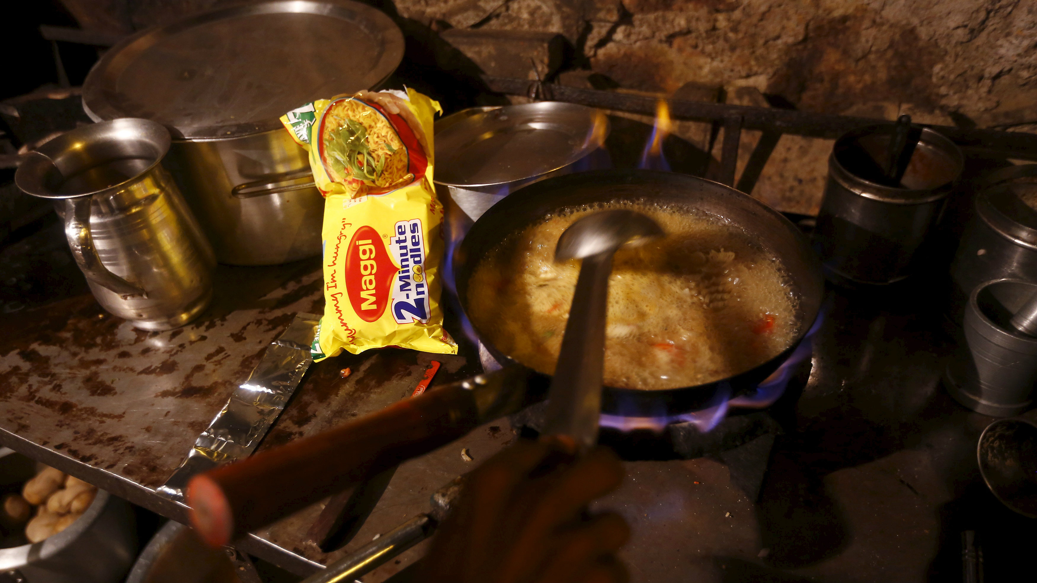A vendor prepares Maggi noodles at a roadside eatery in New Delhi, India, June 7, 2015