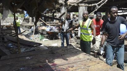Rescue workers at the site of a suicide bomb attack at a market in Maiduguri , Nigeria,