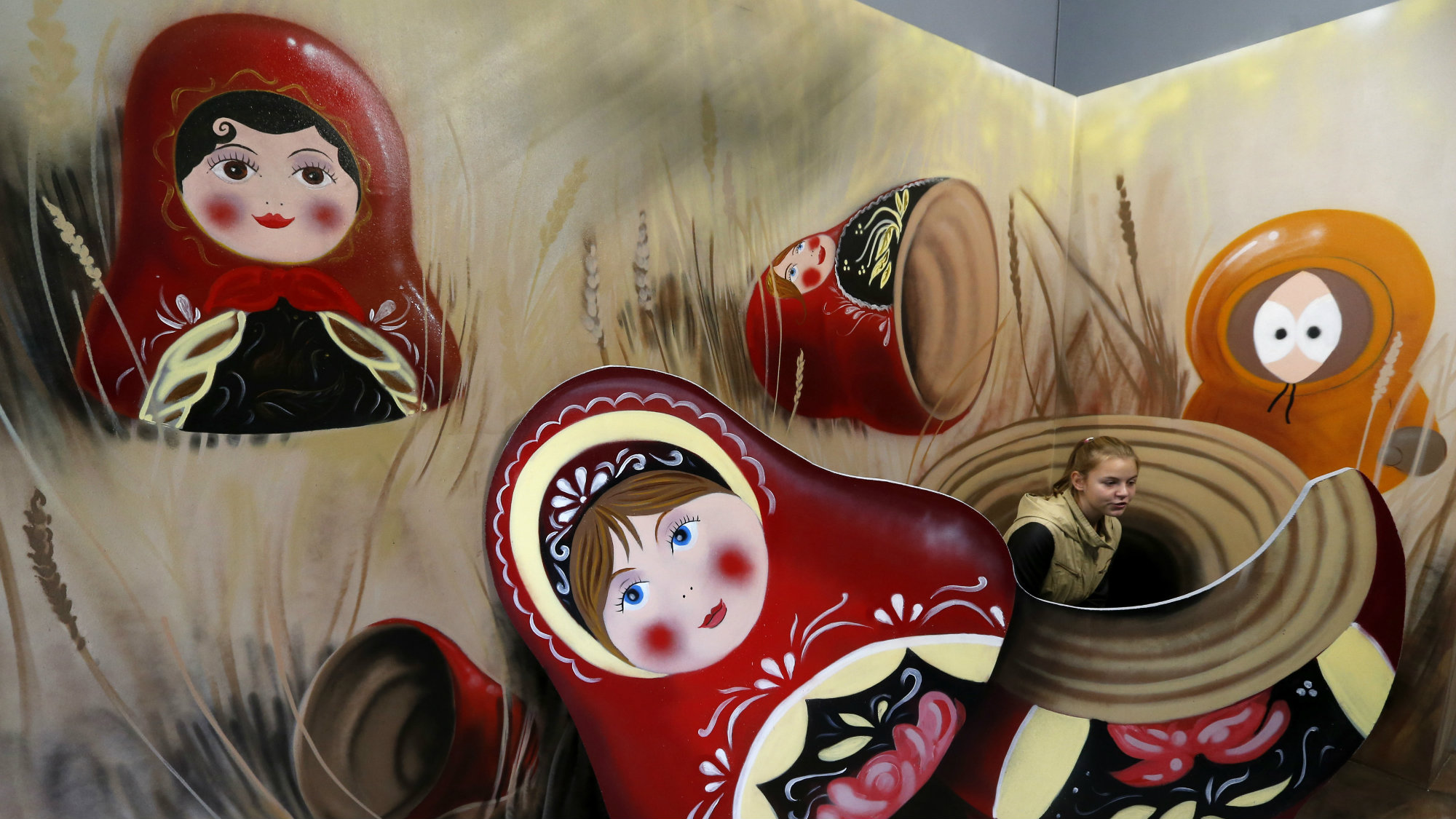A girl looks at an art installation depicting Matryoshka dolls, or Russian nesting dolls, at the Museum of Optical Illusions in St. Petersburg, October 7, 2014. The museum offers visitors a chance to become involved in their 3D installations, according to local media. REUTERS/Alexander Demianchuk (RUSSIA - Tags: SOCIETY)