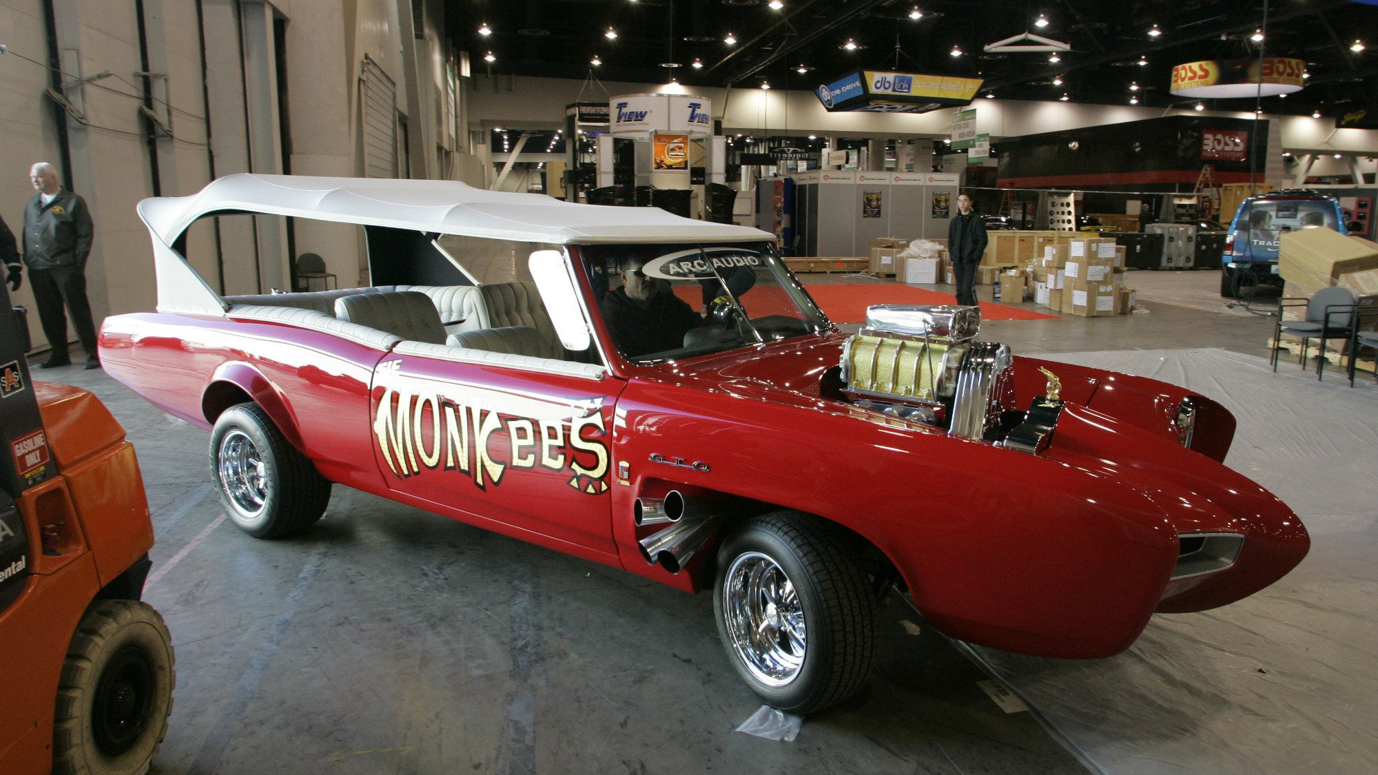 Chris Merrill drives the Monkee-mobile into the exhibit floor at the Las Vegas Convention Center for the Arc Audio display at the 2007 International CES (Consumer Electronics Show) in Las Vegas, Nevada January 6, 2007. Car designer Dean Jeffries created the Monkee Mobile for the 1960's television sit-com starring The Monkees. This year's show runs from January 8-11 and is expected to draw over 150,000 attendees. REUTERS/Steve Marcus (UNITED STATES)