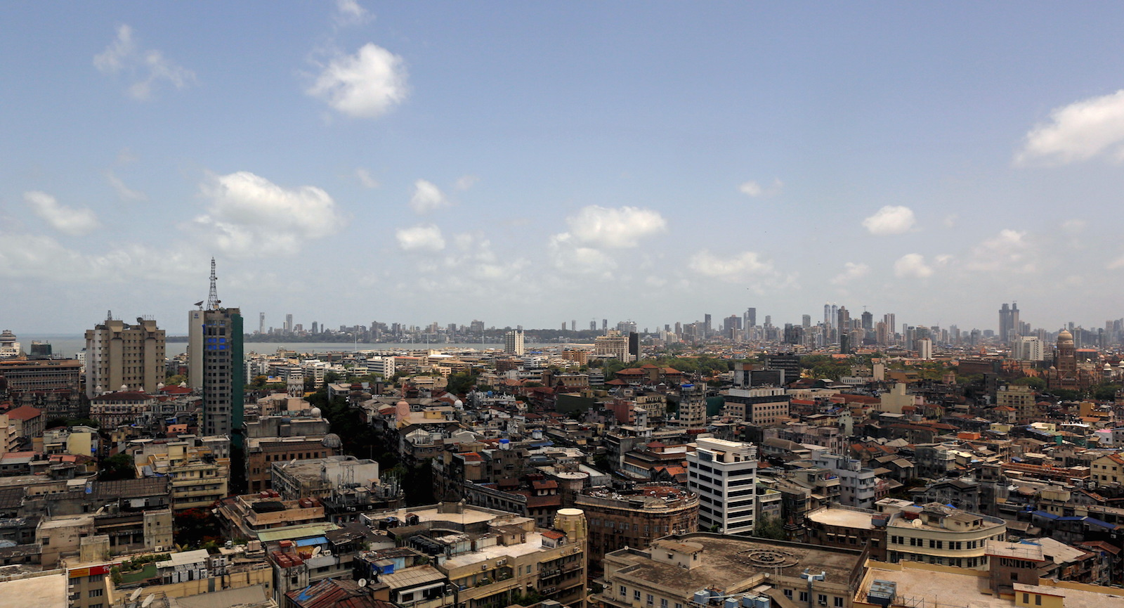 Scattered clouds are seen over Mumbai's skyline, India, June 2, 2015. India cut this year's forecast for monsoon rains to 88 percent of the long-term average, Earth Sciences Minister Harsh Vardhan said on Tuesday, raising fears of a drought in the country where nearly half of farmland lacks irrigation facilities.