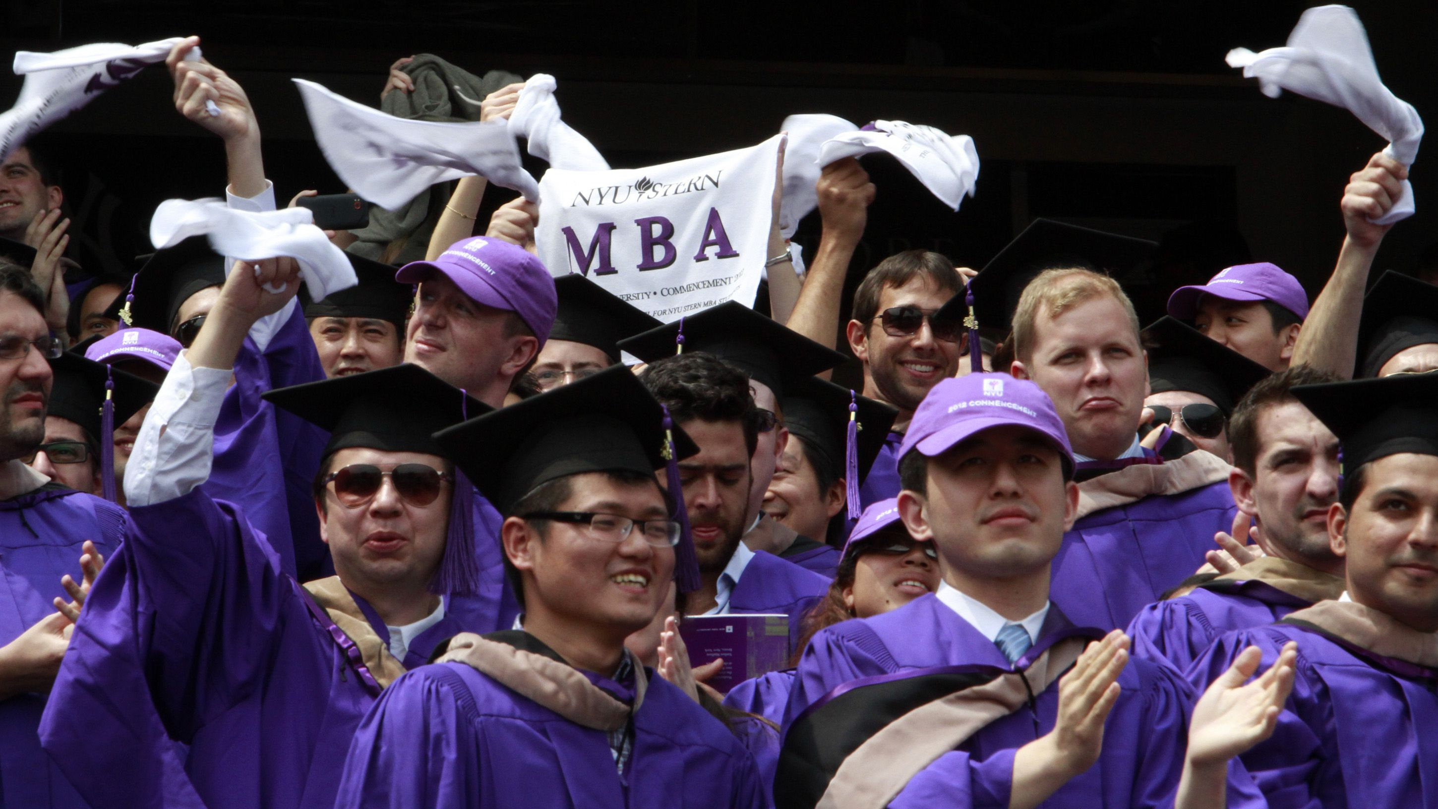 "Graduates from the Leonard N. Stern School of Business cheer and wave ""MBA"" towels as they are declared degree candidates, during the New York University 180th commencement ceremony at Yankee Stadium on Wednesday, May 16, 2012 in New York.  (AP Photo/Bebeto Matthews)"