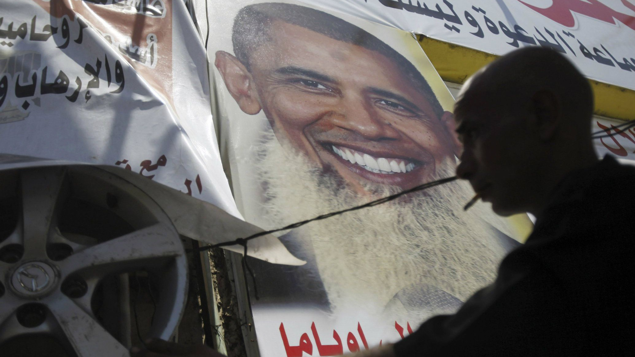 "Salah Abdel Moneim, 40, an anti-Mursi supporter of Egypt's army works at his shop with a poster depicting U.S. president Barack Obama with a beard, in downtown Cairo August 7, 2013. Egypt's presidency said on Wednesday that diplomatic efforts to end the country's political turmoil had failed and warned that the Muslim Brotherhood of ousted President Mohamed Mursi would be held responsible for the consequences. In a statement, interim President Adly Mansour's office said the period of international efforts that began more than 10 days ago had ""ended today"". REUTERS/Amr Abdallah Dalsh"