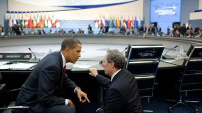 President Barack Obama talks with Mike Froman, Deputy National Security Advisor for International Economic Affairs, during the afternoon session of the G-20 Pittsburgh Summit at the David L. Lawrence Convention Center in Pittsburgh, Penn., Sept. 25, 2009.