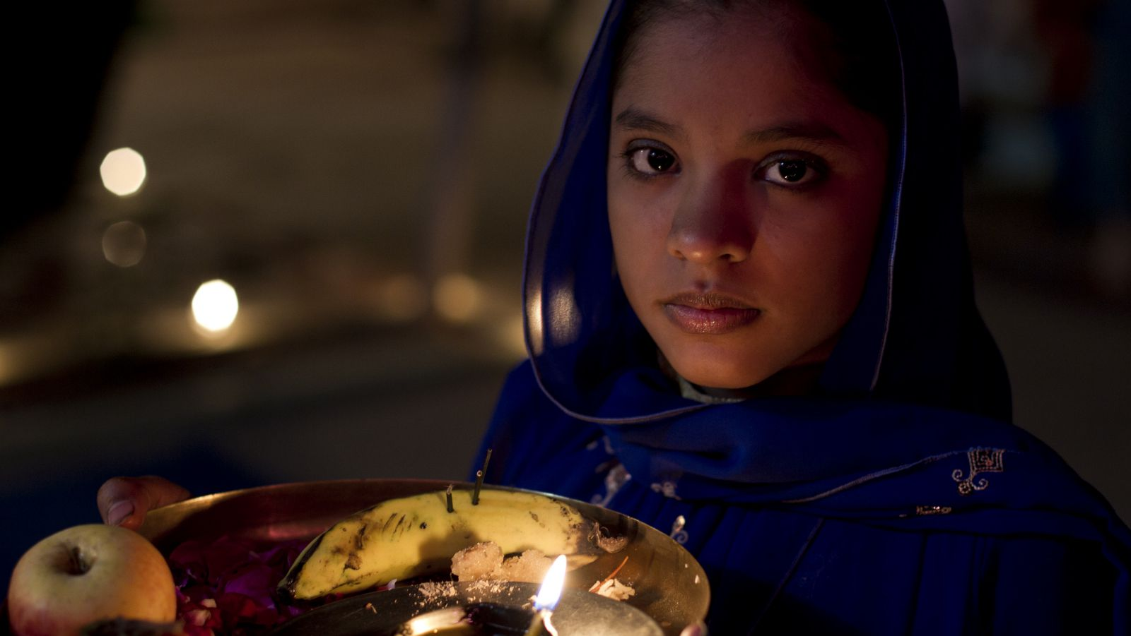 A Pakistani Hindu girl receives guests at a temple to celebrate Diwali festival in Rawalpindi, Pakistan, on Wednesday, Nov. 14, 2012. Diwali, the festival of lights dedicated to the Goddess of wealth Lakshmi, is being celebrated across the country.