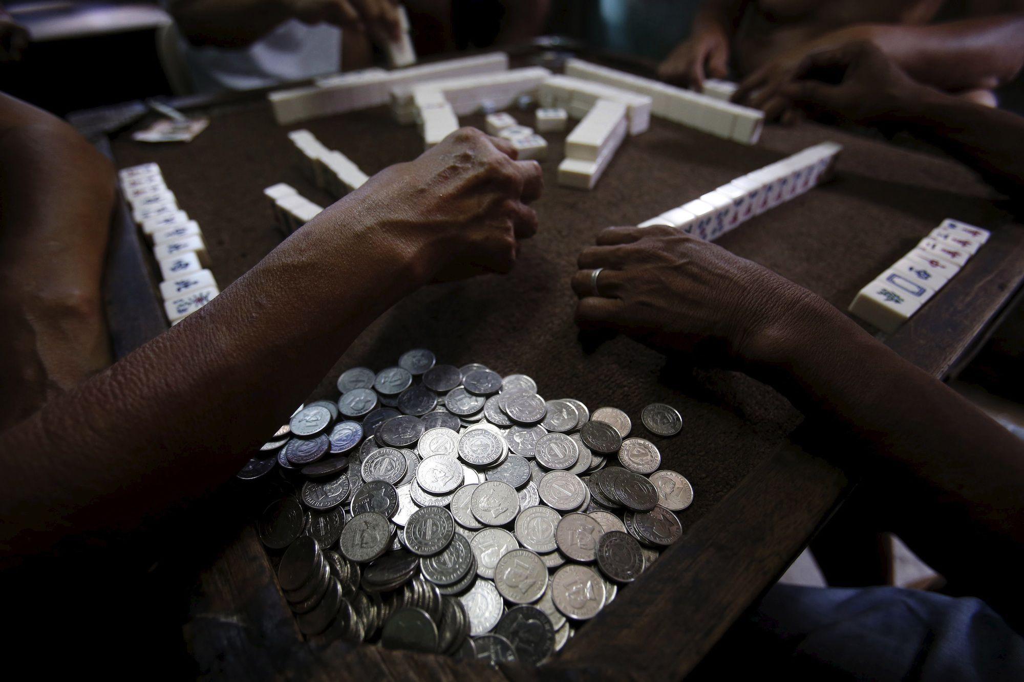 Residents play mahjong in Malabon, Manila.