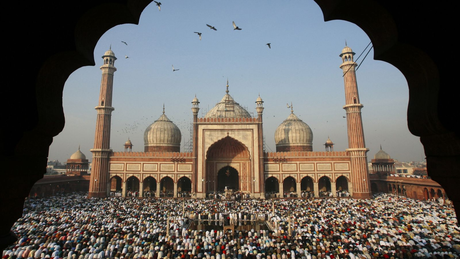 Why indian muslims are using the arabic word ramadan instead of muslims perform eid al adha prayers at jama masjid grand mosque in the kristyandbryce Images