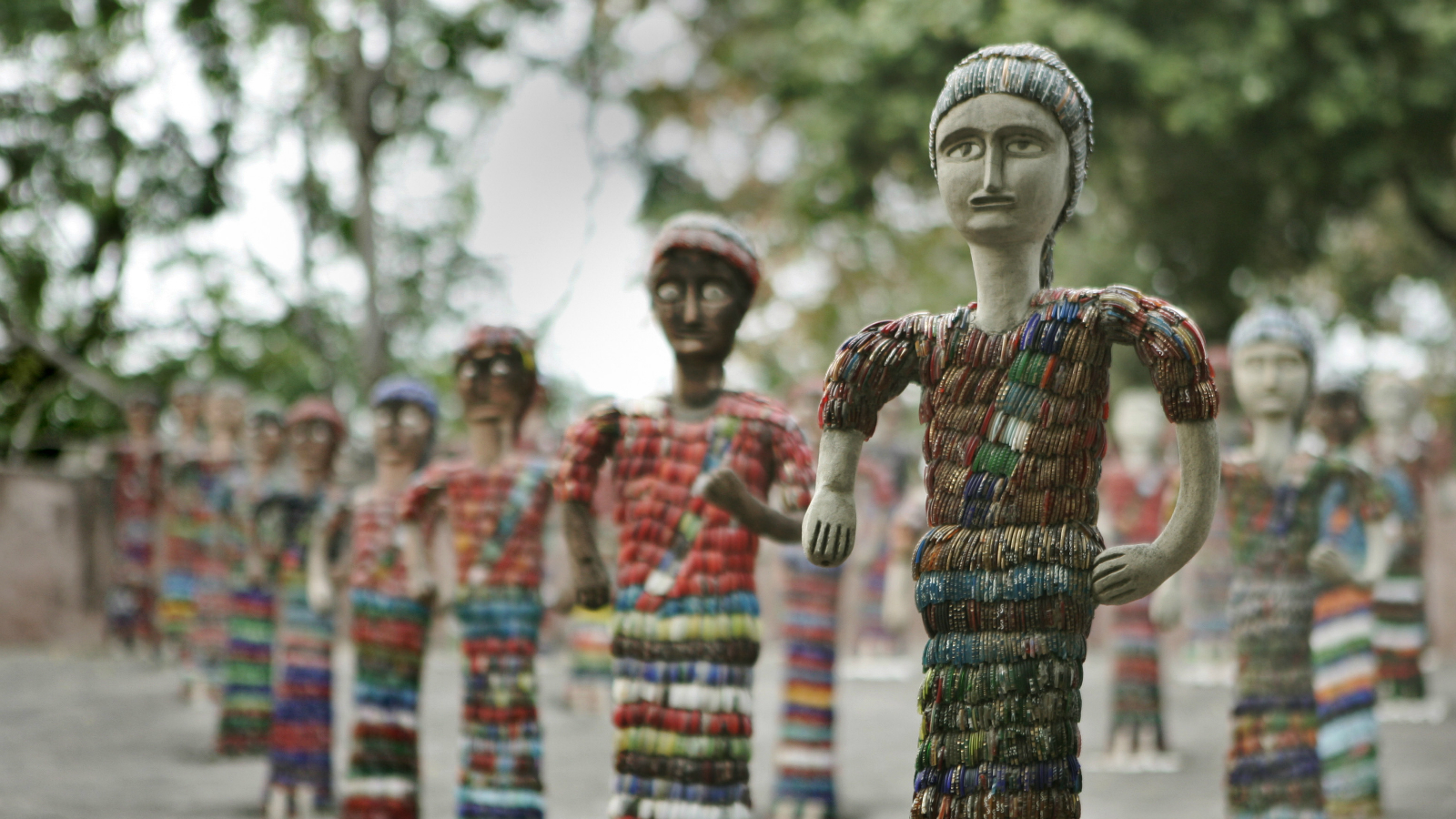 Figures of women studded with broken glass bangles are seen at the Nek Chand Rock Garden in Chandigarh, India, Thursday Dec. 6, 2007. The Rock Garden is a sculpture garden built from recycled industrial and domestic waste. (AP Photo/Aman Sharma)