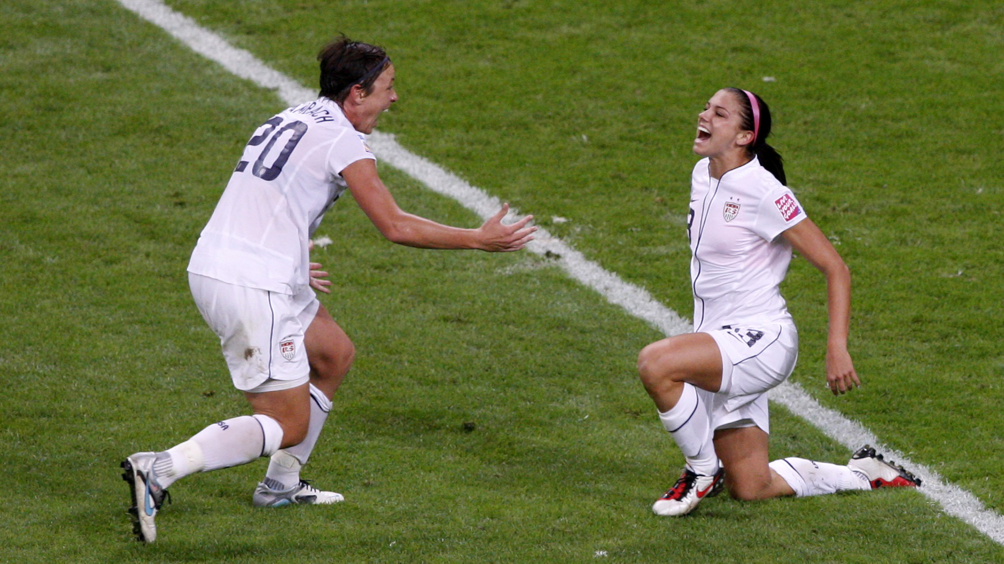 Morgan of the US celebrates a goal against Japan with teammate Wambach during their Women's World Cup final soccer match in Frankfurt