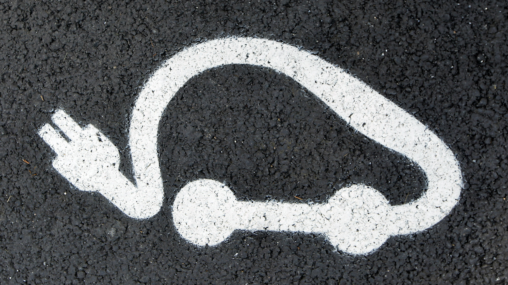 The logo of the Paris Autolib' electric car is painted on the road.