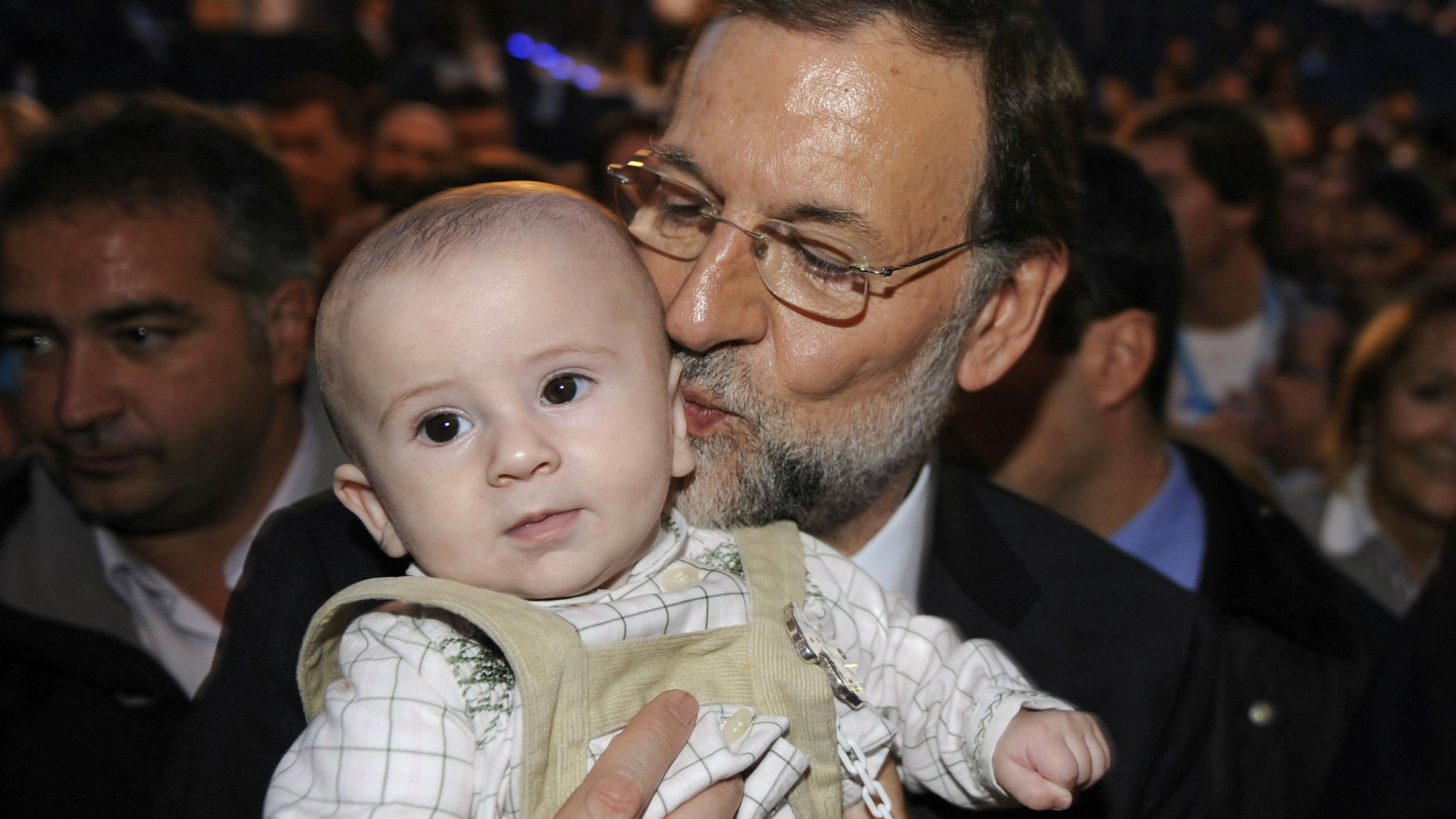 Spain's People's Party (Partido Popular) leader Mariano Rajoy kisses a baby after a rally in Oviedo, northern Spain.
