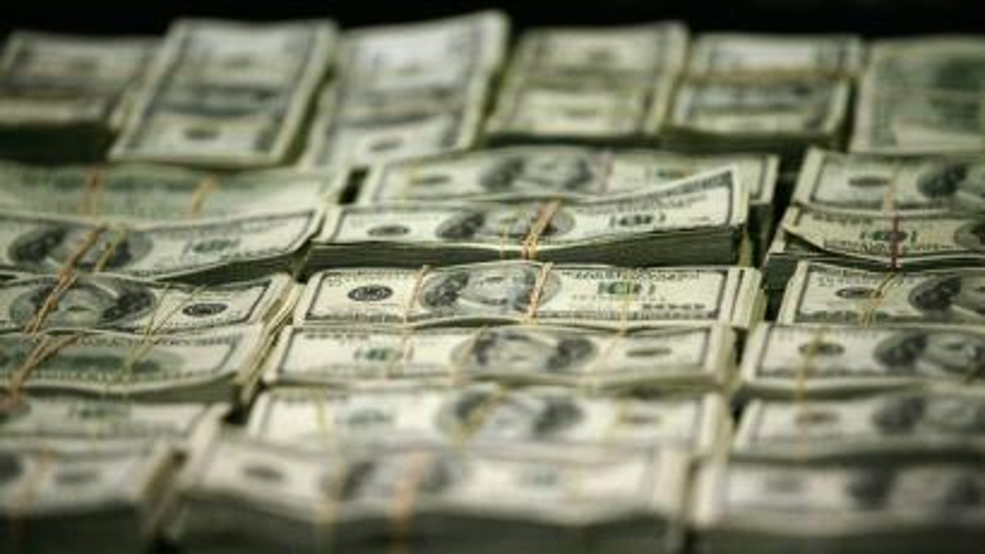 Stacks of U.S. hundred dollar bills.