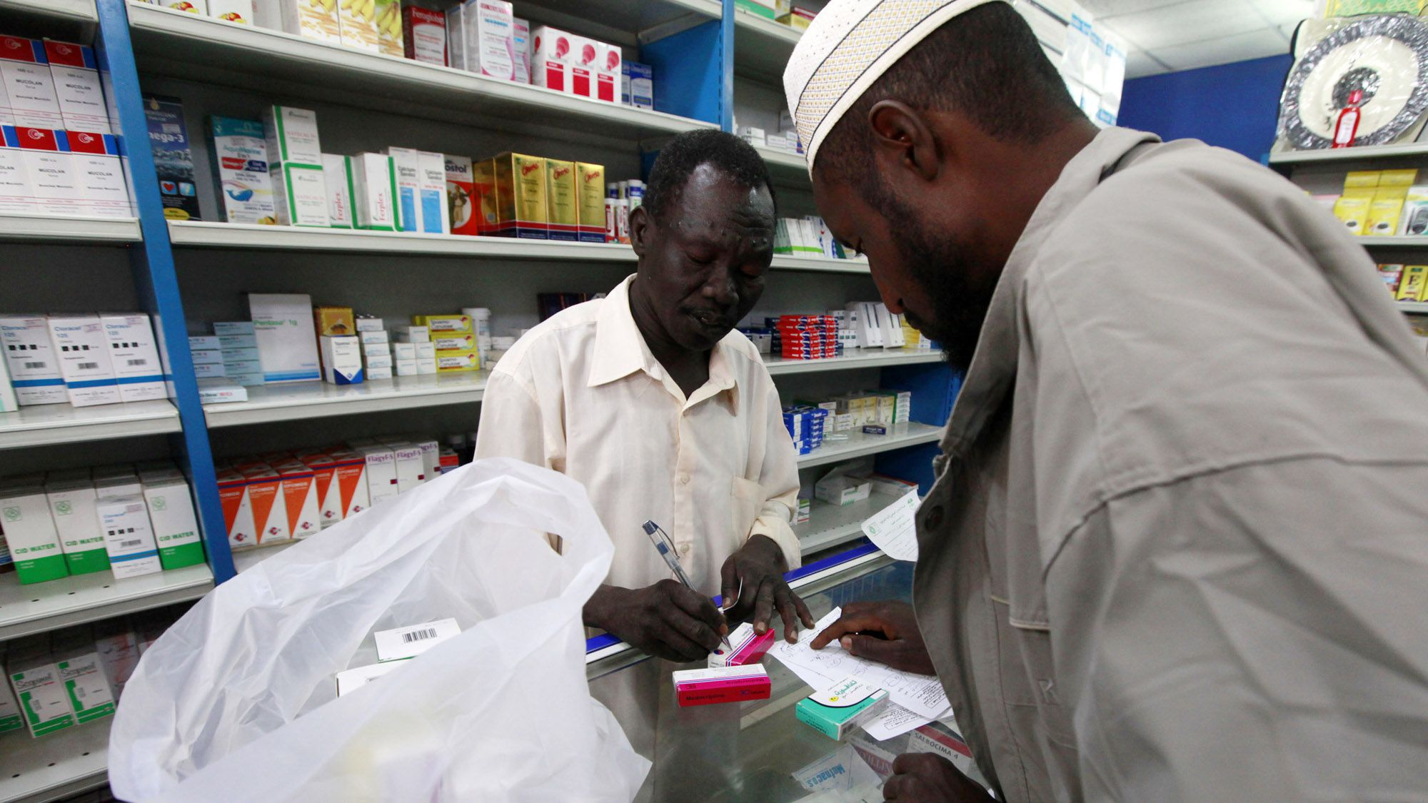 A customer buys medication at a pharmacy in Khartoum, January 24, 2012. Doing business has never been easy in Sudan, which suffers from a U.S. trade embargo, poverty, high inflation and the legacy of years of armed conflict. Even so the country, home to 32 million people and rich in oil, minerals such as gold and copper, and vast areas of farmland, has always attracted investors who do not mind taking some risks. But the investment climate has deteriorated further since South Sudan took away two-thirds of the country's oil production when it seceded in July.  Picture taken January 24, 2012.