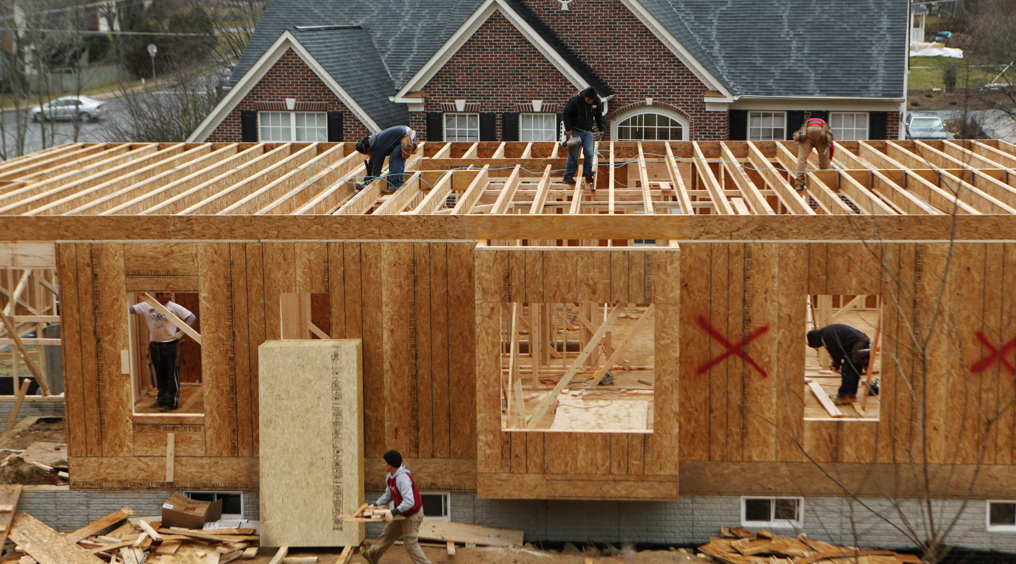 Builders work on a house in Alexandria, Virginia