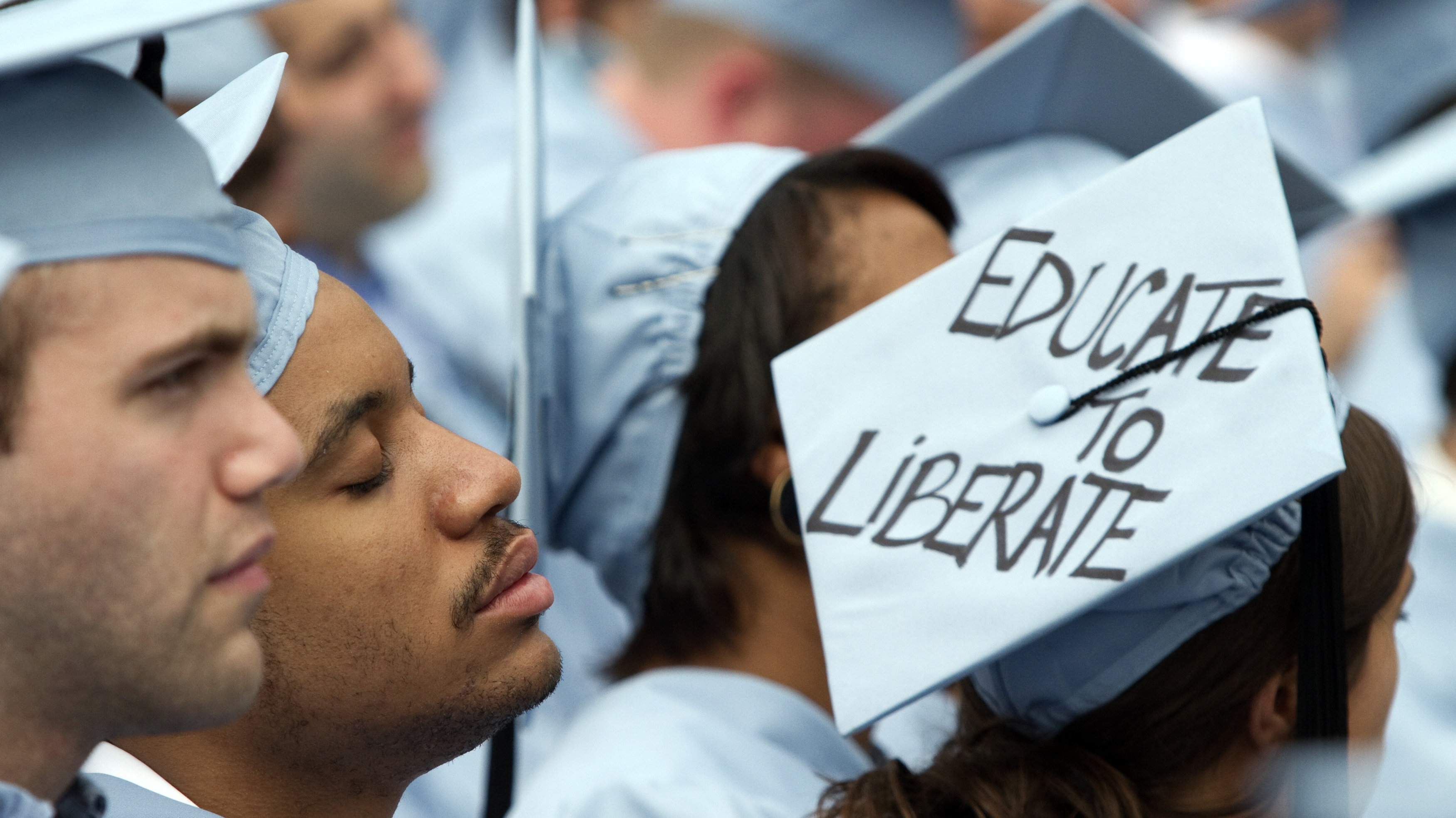 Graduate from Columbia University's School of Engineering sleeps during the university's commencement ceremony in New York