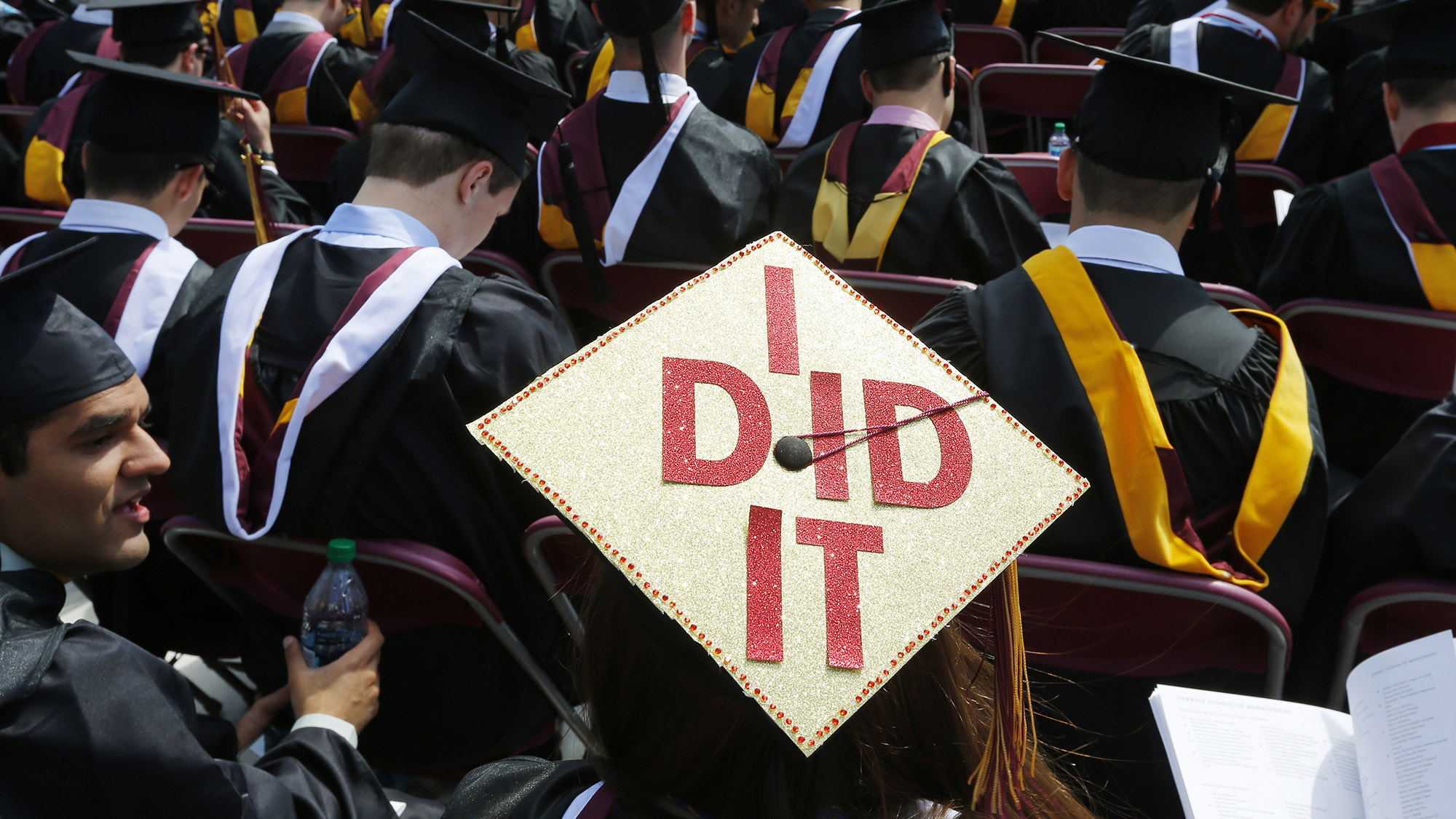 "Graduating student Katherine Thomas has ""I Did It"" written on her mortar board during Commencement Exercises at Boston College."