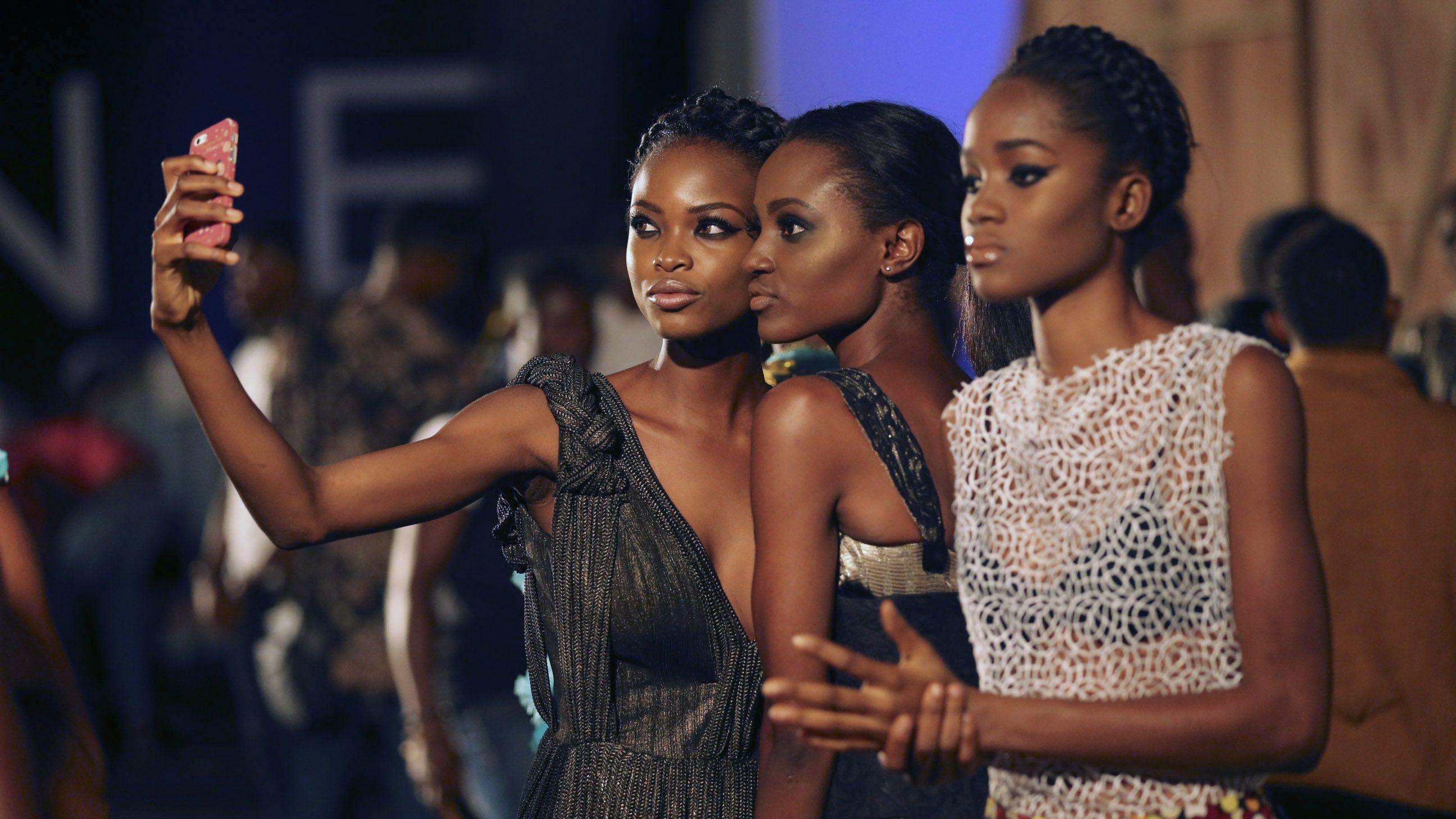 Models take a selfie backstage during Lagos fashion and design week October 29, 2014. Picture taken October 29, 2014.