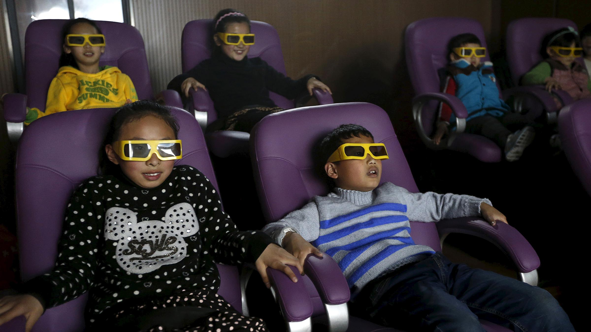 Children watch a 3D movie at a community theatre in Hefei