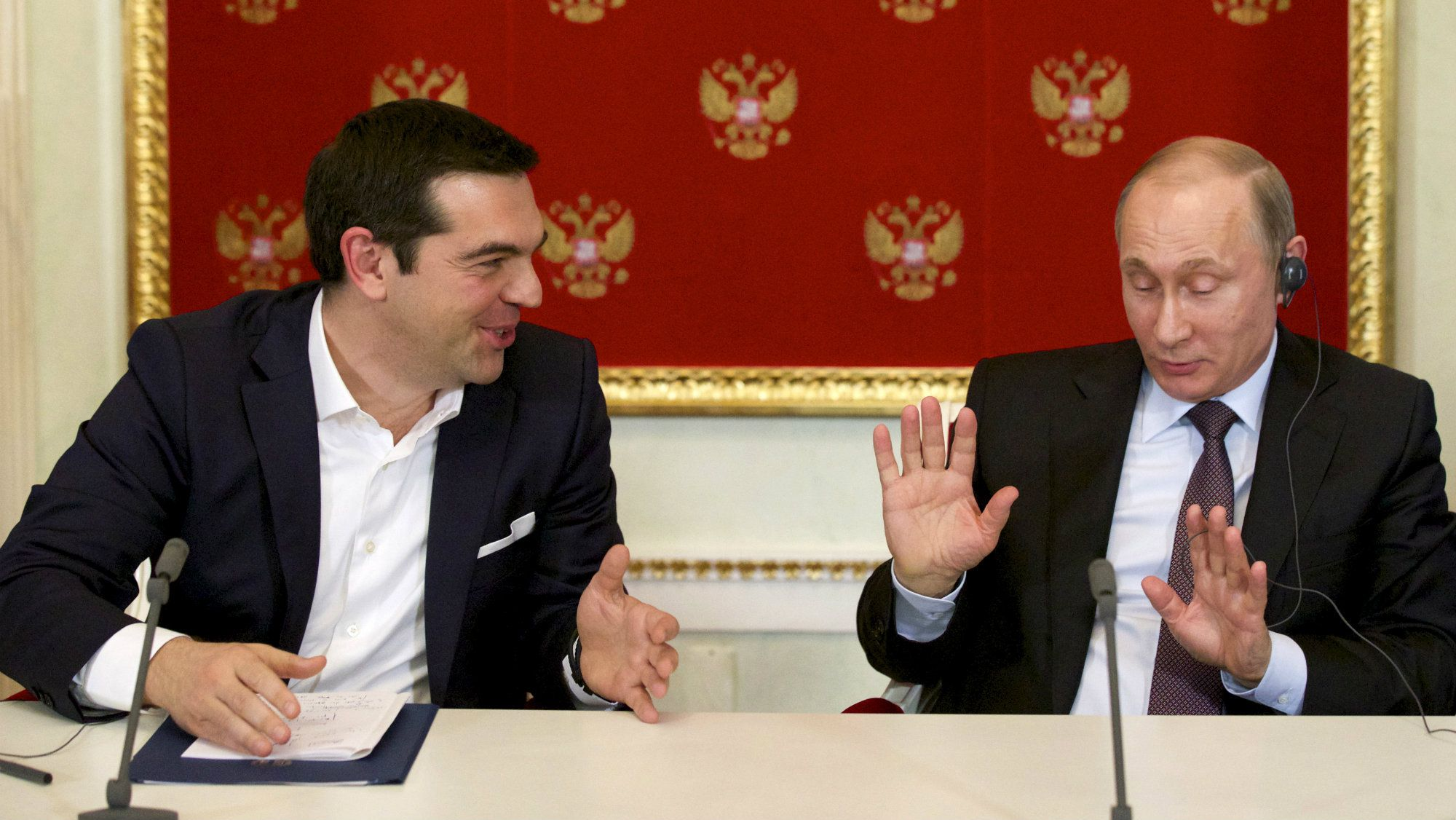 Russian President Vladimir Putin (R) and Greek Prime Minister Alexis Tsipras attend a signing ceremony at the Kremlin in Moscow, April 8, 2015.