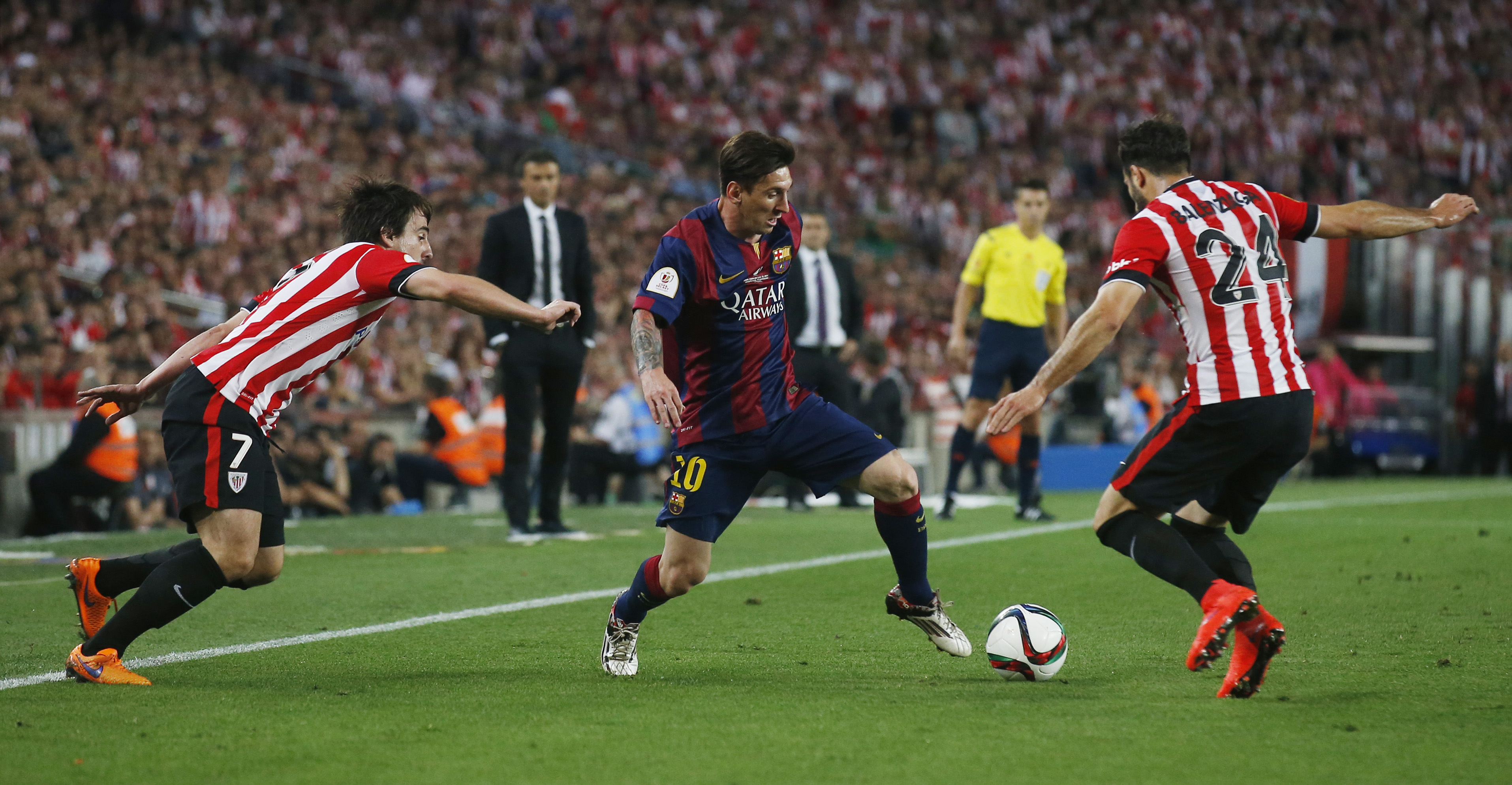 Lionel Messi goes past Benat and Mikel Balenziaga on his way to score the first goal for Barcelona.