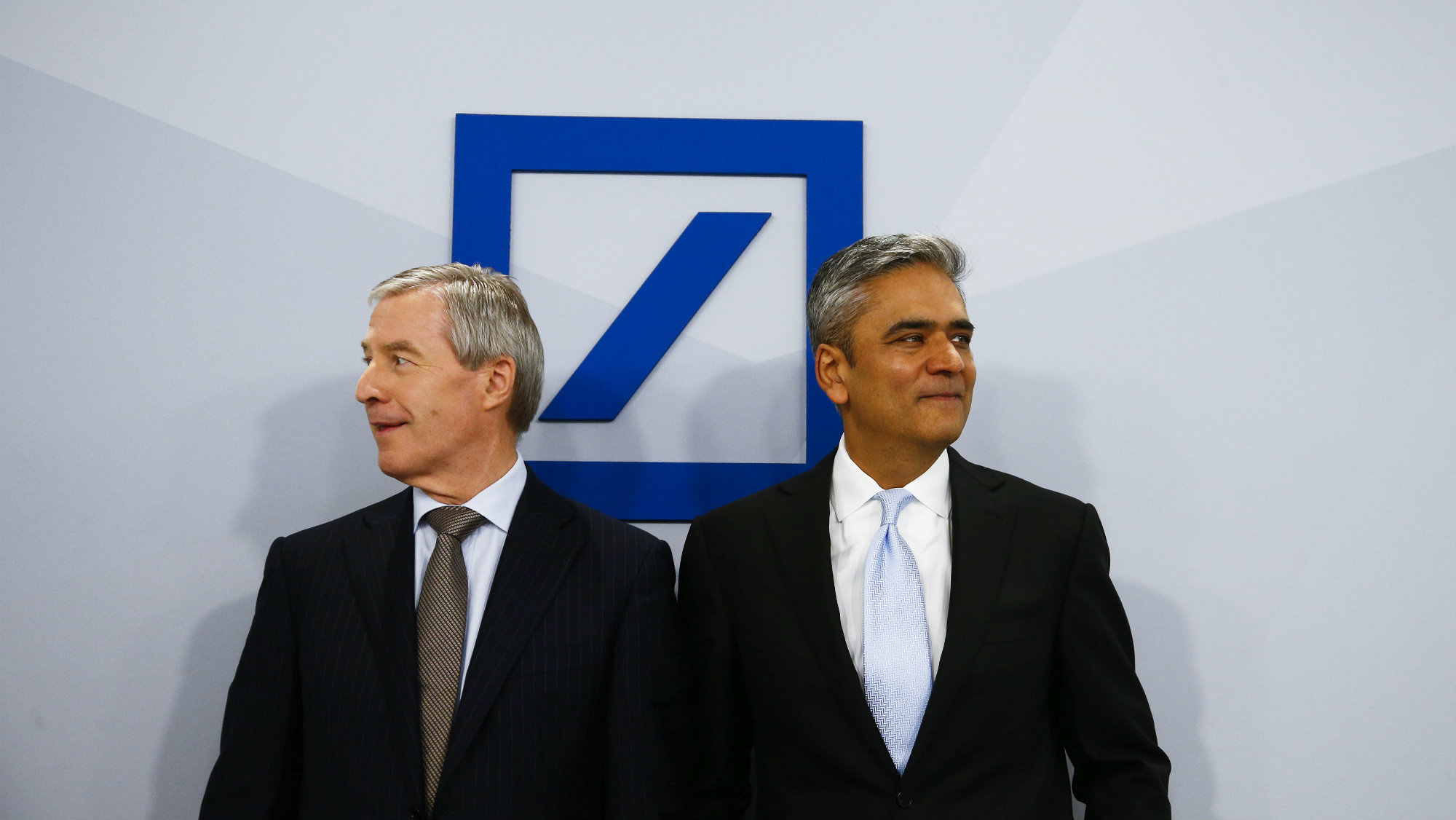 Anshu Jain (R) and Juergen Fitschen, Co-CEOs of Deutsche Bank AG arrive for the bank's annual news conference in Frankfurt.