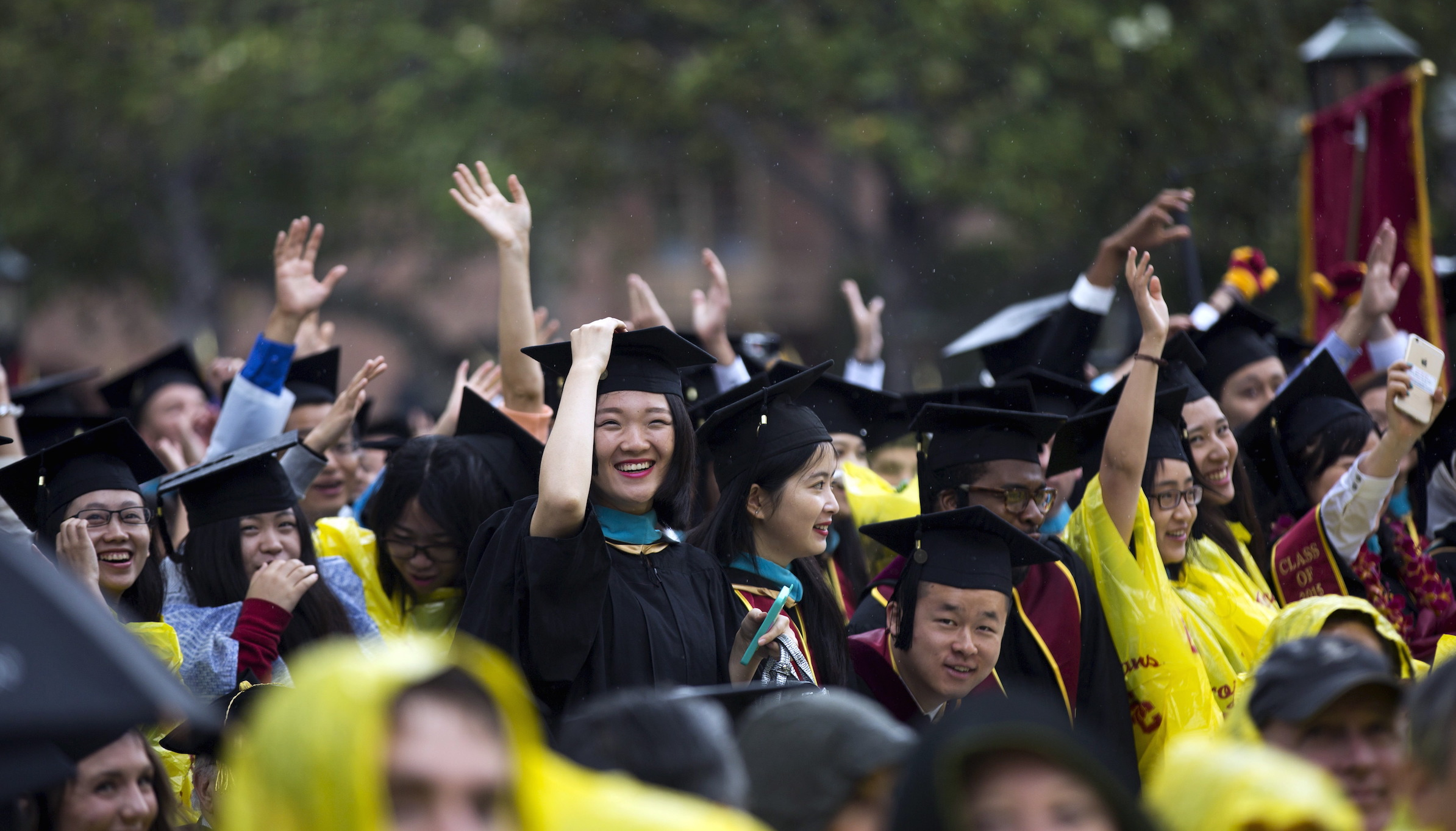 Graduating students cheer during USC's Commencement Ceremony at University of Southern California in Los Angeles, California May 15, 2015. REUTERS/Mario Anzuoni - RTX1D635