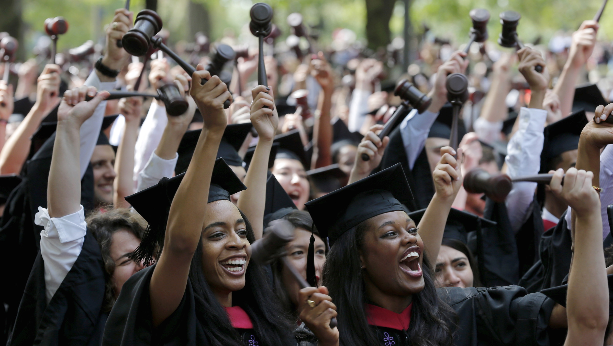 Students graduating from the School of Law cheer as they receive their degrees during the 364th Commencement Exercises at Harvard University in Cambridge, Massachusetts May 28, 2015.    REUTERS/Brian Snyder - RTX1EZC9