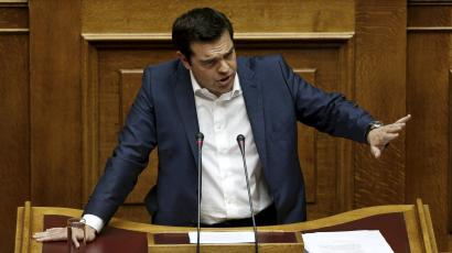 Greek Prime Minister Alexis Tsipras delivers a speech during a parliamentary session to brief lawmakers over the ongoing talks with the country's lenders.