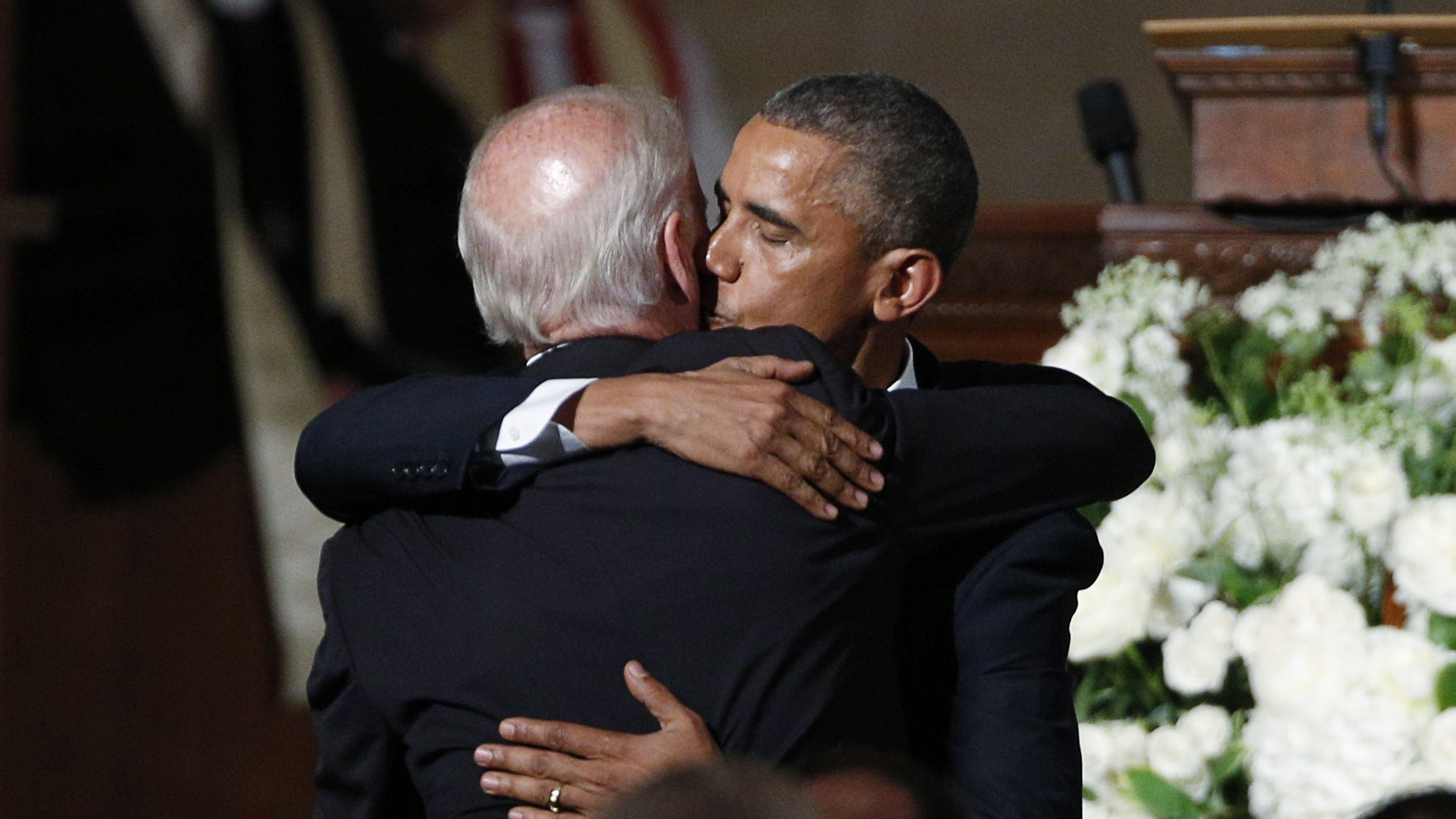 U.S. President Barack Obama kisses Vice President Joe Biden on the cheek as he hugs him after delivering the eulogy during the funeral of Biden's son, former Delaware Attorney General Beau Biden, at St. Anthony of Padua church in Wilimington, Delaware June 6, 2015.