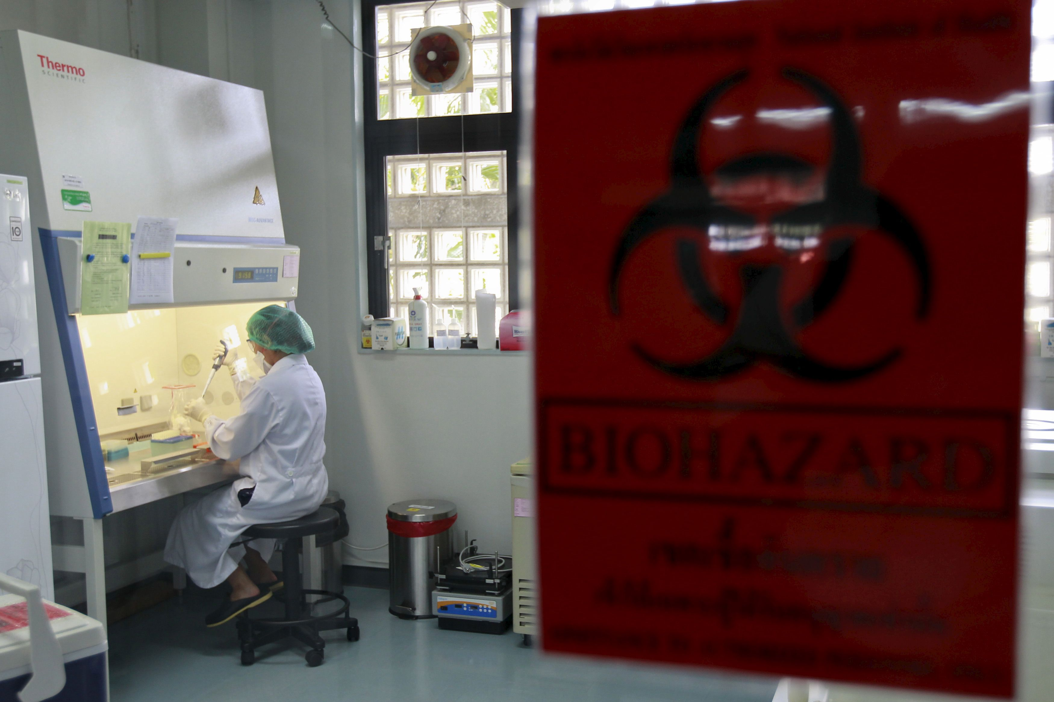 A lab staff tests a fluid sample taken from people who recently returned from South Korea and are suspected of Middle East Respiratory Syndrome (MERS) infection inside a sample preparation lab at the National Institute of Health Department of Medical Sciences in Nonthaburi province, on the outskirts of Bangkok, Thailand, June 18, 2015. REUTERS/Chaiwat Subprasom  - RTX1H1UF
