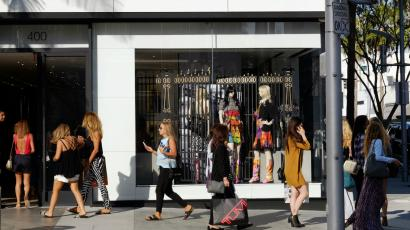 Shoppers walk past the Chanel Boutique on Rodeo Drive in Beverly Hills, California.