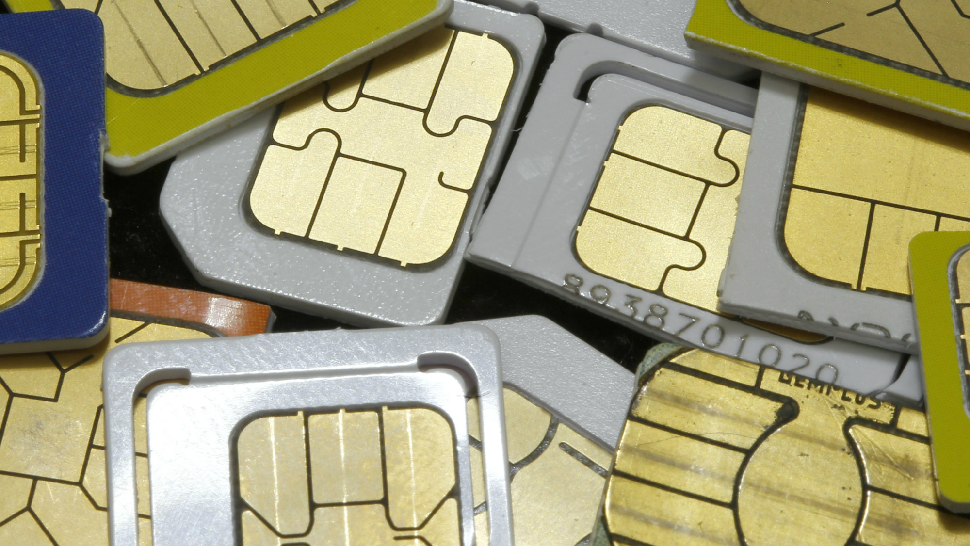 SIM cards lie on a table in this photo illustration taken in Sarajevo February 24, 2015. Franco-Dutch technology firm Gemalto, the world's biggest maker of phone SIM cards, will not pursue any legal action against government agencies it says are probably behind a large-scale hacking attempt as chances of success are nearly nonexistent, CEO Olivier Piou said February 25, 2015. Gemalto makes smart chips for mobile phones, bank cards and biometric passports and counts Verizon , AT&T Inc. and Vodafone among its 450 wireless network provider customers around the world. Picture taken Febryary 24. REUTERS/Dado Ruvic (BOSNIA AND HERZEGOVINA - Tags: BUSINESS SCIENCE TECHNOLOGY CRIME LAW TPX IMAGES OF THE DAY)