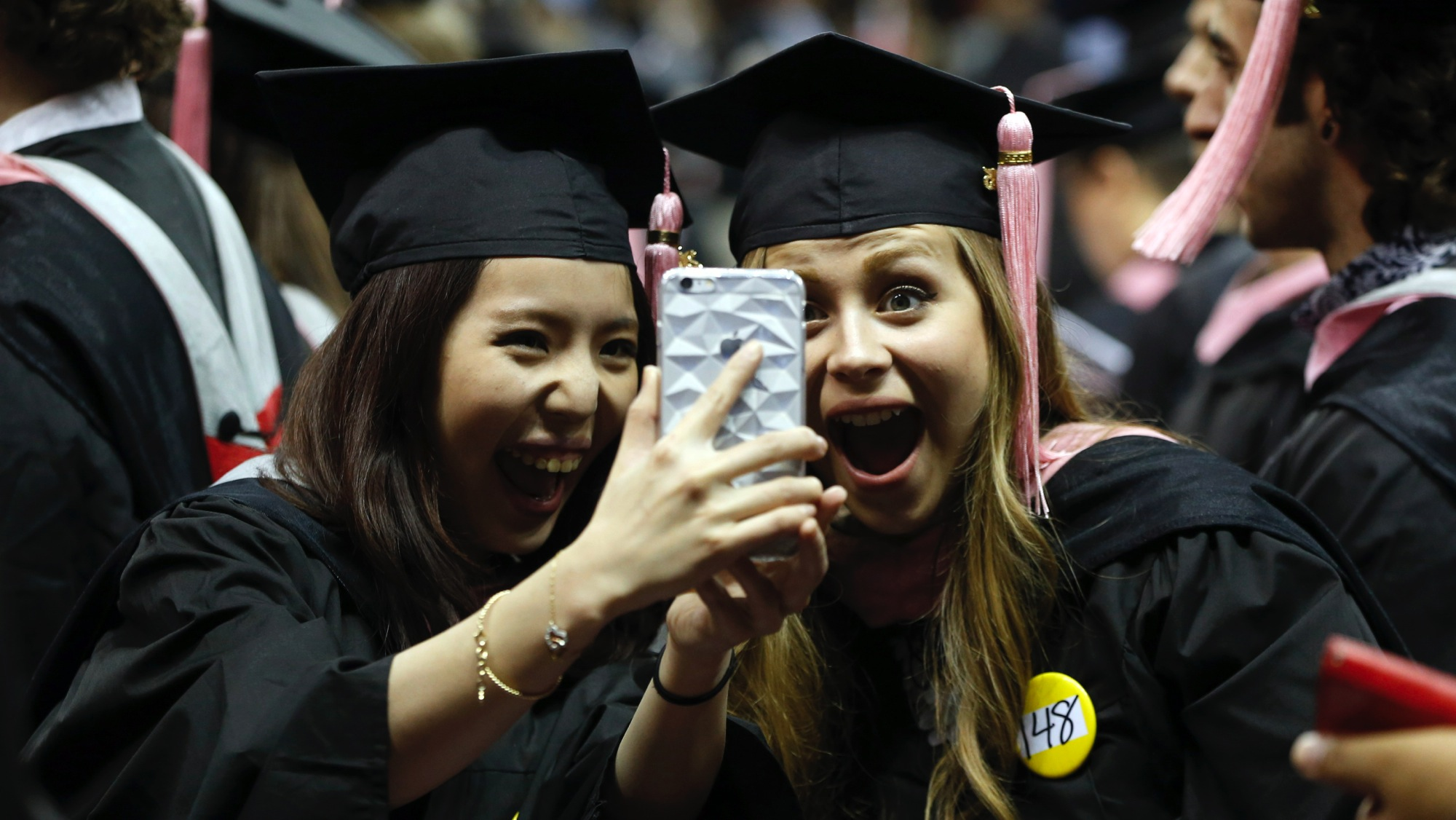 Berklee College of Music graduates take a selfie during commencement ceremonies, Saturday, May 9, 2015, in Boston. (AP Photo/Michael Dwyer)