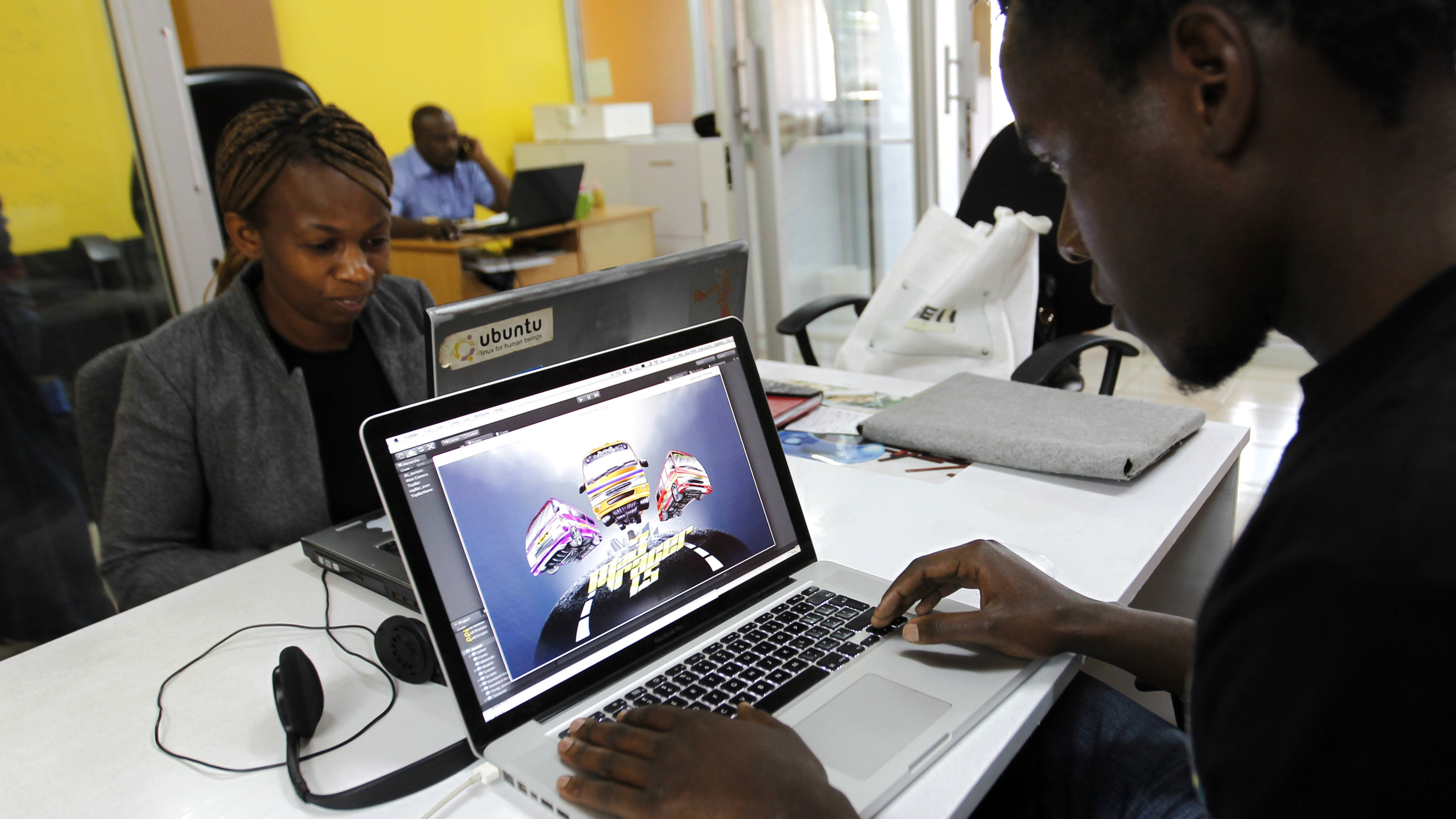 Duncan Onyango, a game design developer at Planet Rackus works on MA3Racer, a 2D mobile game inside his studio in Kenya's capital Nairobi, July 15, 2014.