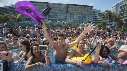 DATE IMPORTED:Spring breakers gather at a pool party at a hotel in Cancun March 8, 2015. Florida has long struggled with the crowds of rowdy students embracing its sun, sea and party life in March and April. Fort Lauderdale announced on television in 1985 that spring breakers were no longer welcome after 350,000 students took nudity and drinking to new heights. Picture taken March 8, 2015. REUTERS/Victor Ruiz Garcia