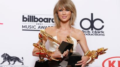 """Taylor Swift poses in the press room with the awards for top Billboard 200 album for """"1989"""", top female artist, chart achievement, top artist, top Billboard 200 artist, top hot 100 artist, top digital song artist, and top streaming song (video) for """"Shake It Off"""" at the Billboard Music Awards at the MGM Grand Garden Arena on Sunday, May 17, 2015, in Las Vegas."""
