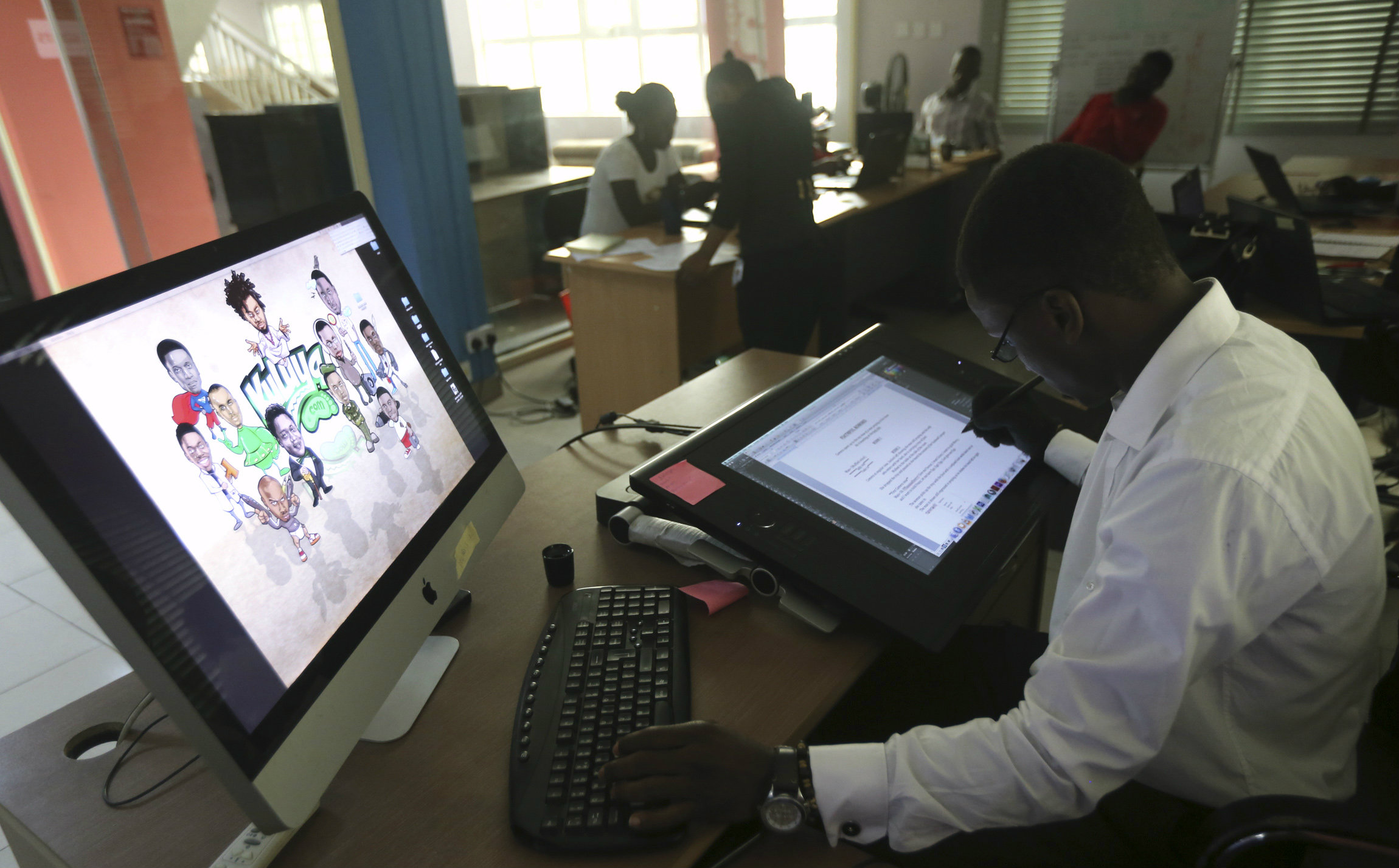 An illustrator works on a digital drawing board at the Kuluya Games office at Anthony district in Nigeria's commercial capital of Lagos June 16, 2014.