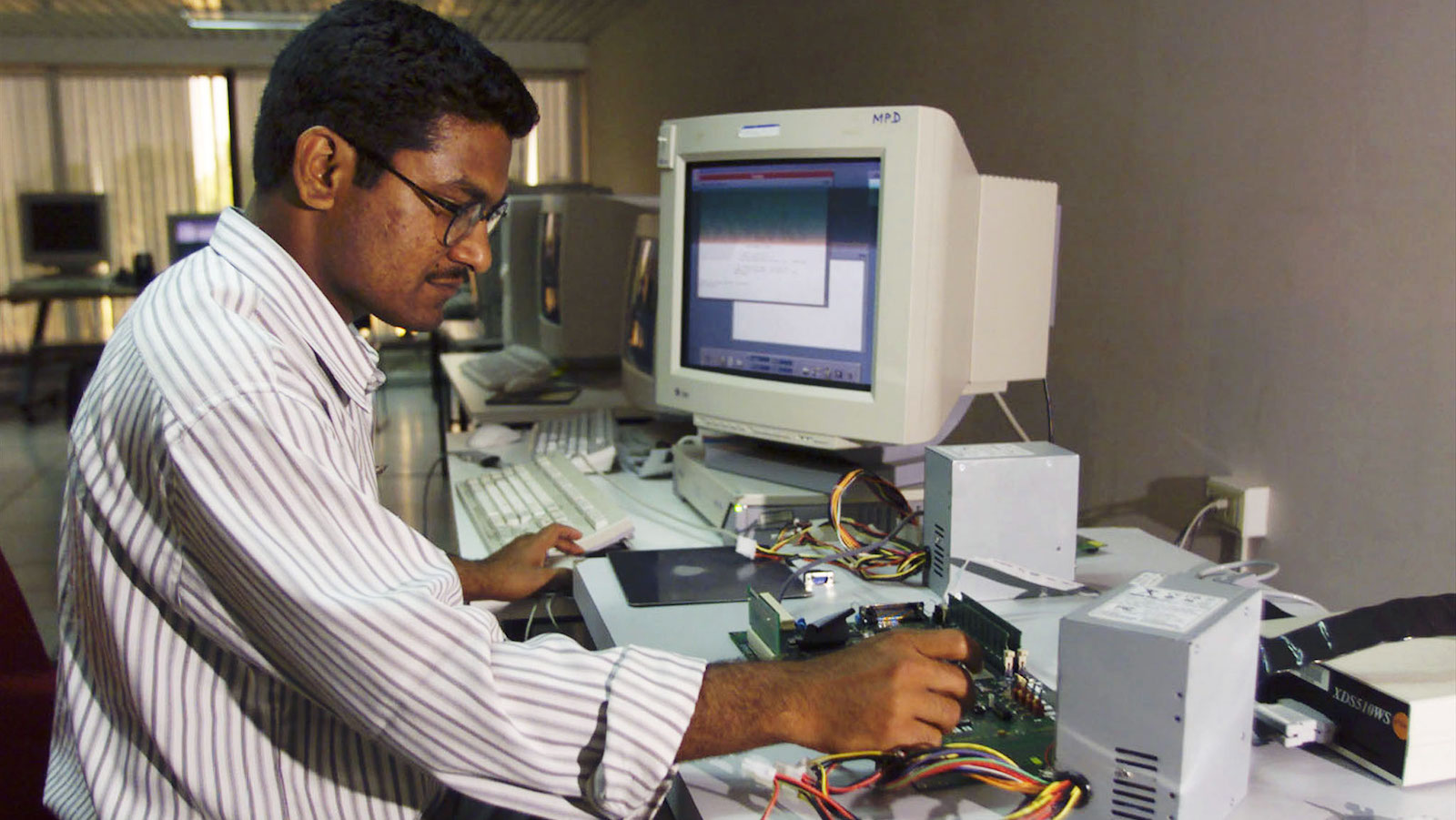 A semi conductor chip designer works on a computer component at the Indian unit of Texas Instruments Inc in Bangalore. Texas Instruments was the first computer software company to set up its operations in the city in 1985. Bangalore today, is home to dozens of global and domestic technology companies employing an estimated 75,000 software professionals and is popularly referred to as Asia's 'Silicon Valley'. Picture taken April 4.