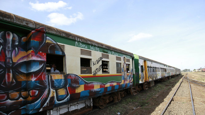 A commuter train is seen at the railway station painted with murals promoting peace after the coming elections in Kenya's capital Nairobi.