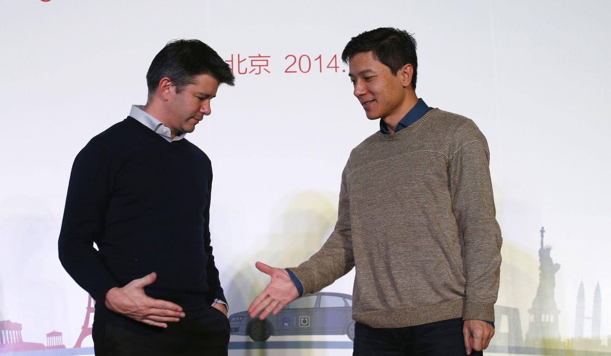 Kalanick (left) with Baidu Baidu chairman and CEO Robin Li.