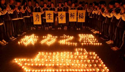 Students pray for passengers on the sunken cruise ship at a school in Zhuji, Zhejiang province.