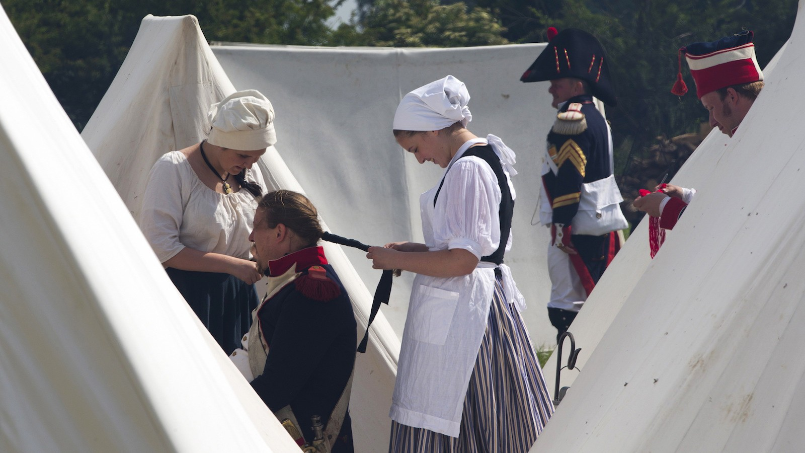 Performers take part in the re-enactment of the visit of French Emperor Napoleon in the French troops' bivouac as part of the bicentennial celebrations for the Battle of Waterloo in Ligny