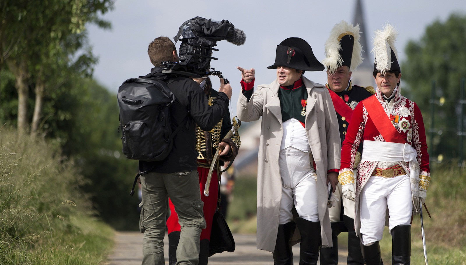 Frenchman Samson gestures as he arrives at the French troops' bivouac while taking part in an re-enactment as French Emperor Napoleon as part of the bicentennial celebrations for the Battle of Waterloo, in Ligny