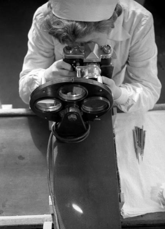 woman inspecting camera