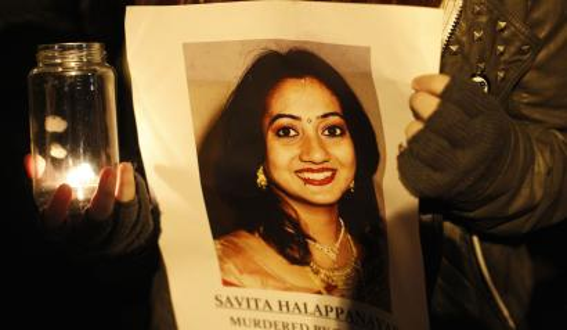 Activist holding photo of Savita Halappanavar