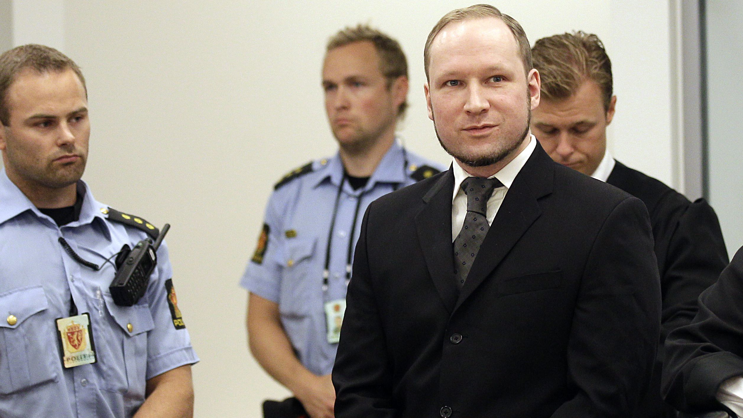 Mass murderer Anders Behring Breivik,  arrives at the courtroom in a courthouse in Oslo  Friday Aug. 24, 2012 .  Breivik was convicted Friday of terrorism and premeditated murder for bomb and gun attacks that killed 77 people and sentenced to a special prison term that would allow authorities to keep him locked up for as long as he is considered dangerous. (AP Photo/Frank Augstein)
