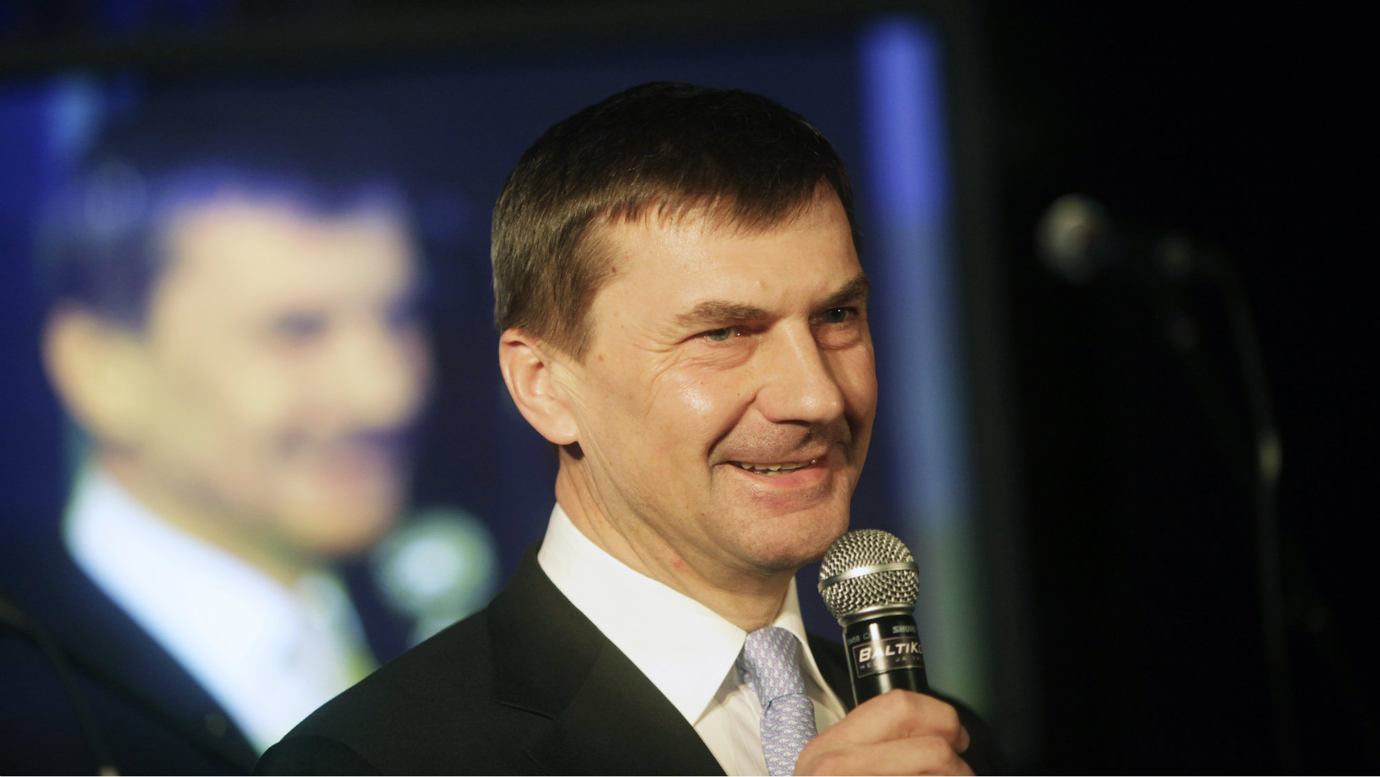 Estonia's acting Prime Minister and Reform Party chairman Andrus Ansip speaks to his party activists as they wait for general election results in Tallinn March 6, 2011. Estonia's center-right government was headed for victory in Sunday's election, early results showed, with the coalition getting credit for a successful adoption of the euro and ending a deep recession. REUTERS/Ints Kalnins (ESTONIA - Tags: POLITICS ELECTIONS)