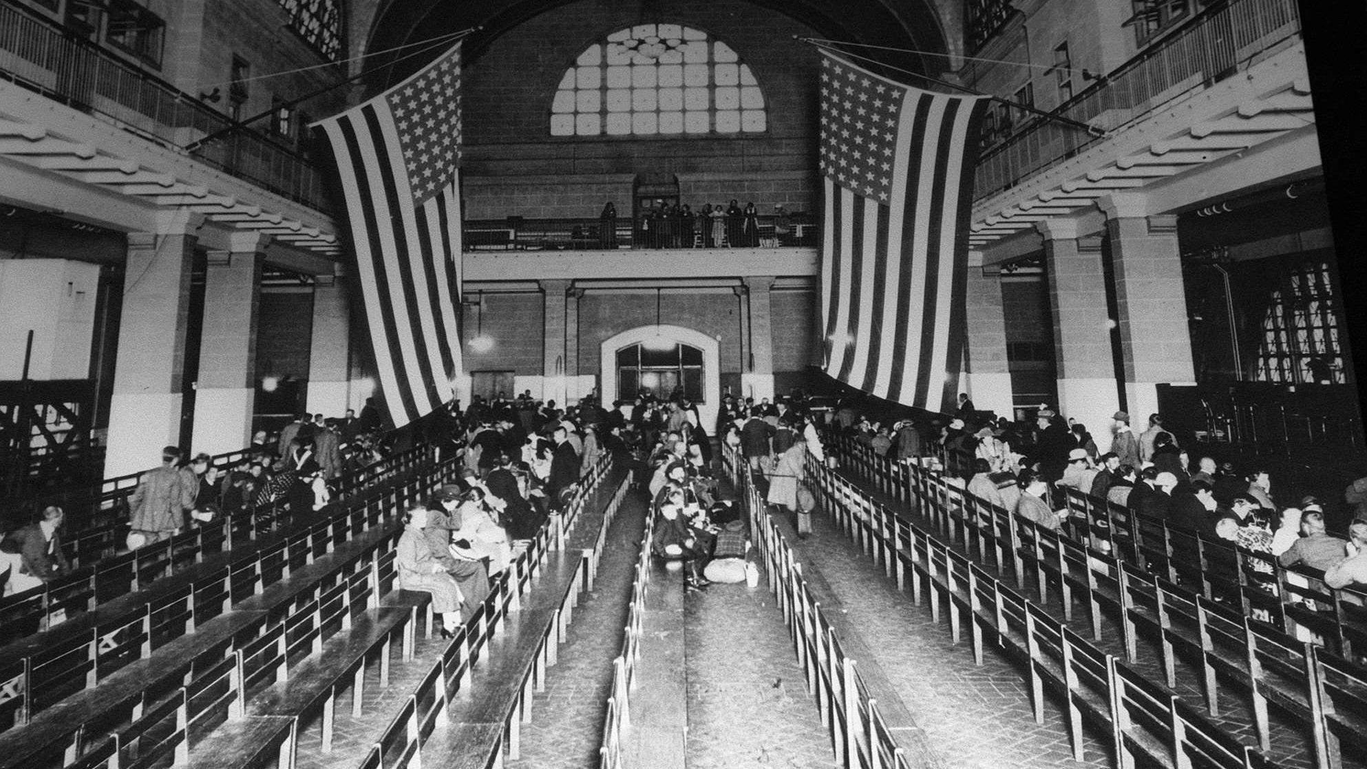 FILE--This is a 1924 photo of the registry room at Ellis Island in New York harbor. New York and New Jersey are involved in a dispute over which state has jurisdiction over the national landmark, which was a gateway to America for millions of immigrants.(AP Photo/file)